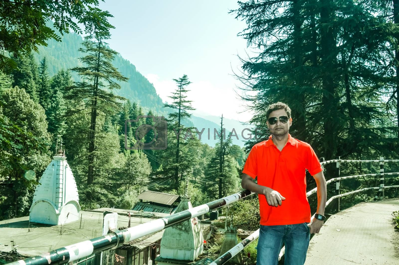A man standing in the heart of Manali City, Himachal Pradesh, Kullu, India. It is a popular tourist destination in northern India.