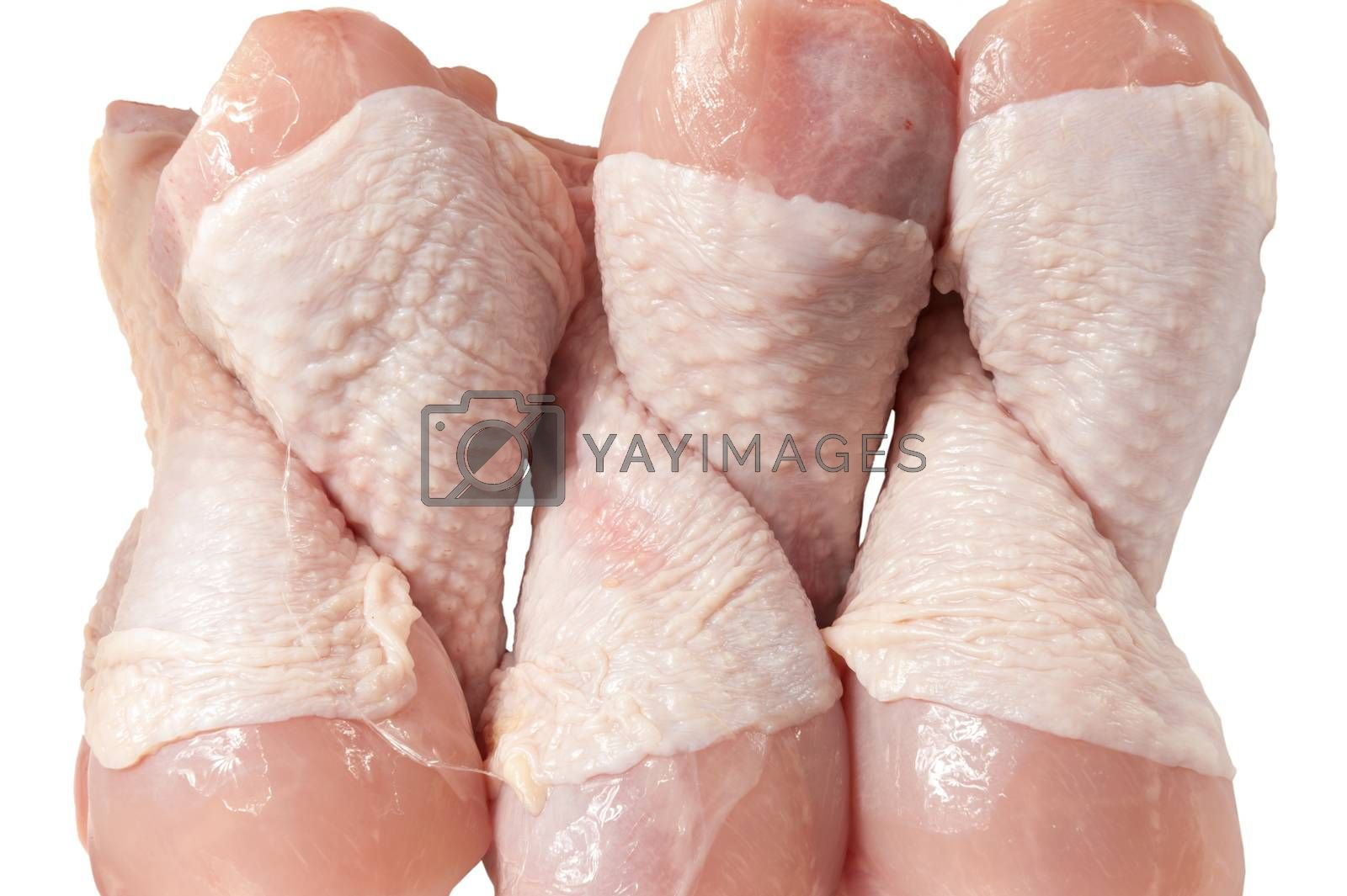 raw chicken legs isolated on white background