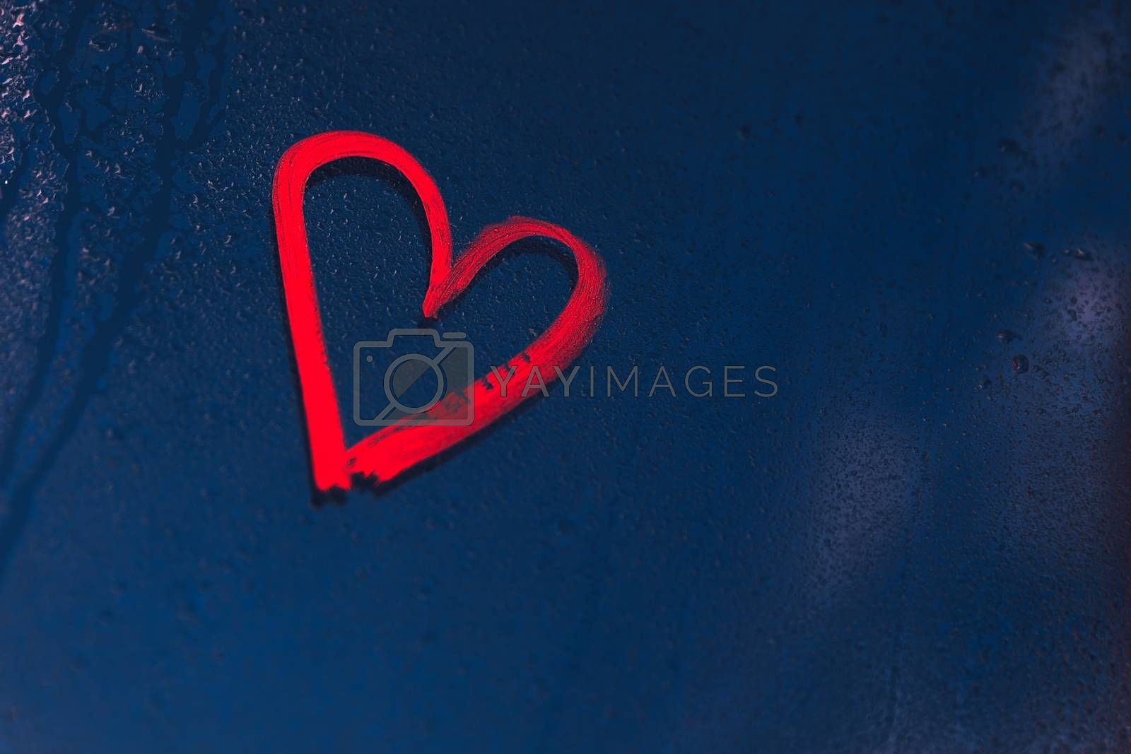 Photo of a heart drawn with red lipstick on a glass on a rainy night, expression of passion, love message on Valentines day