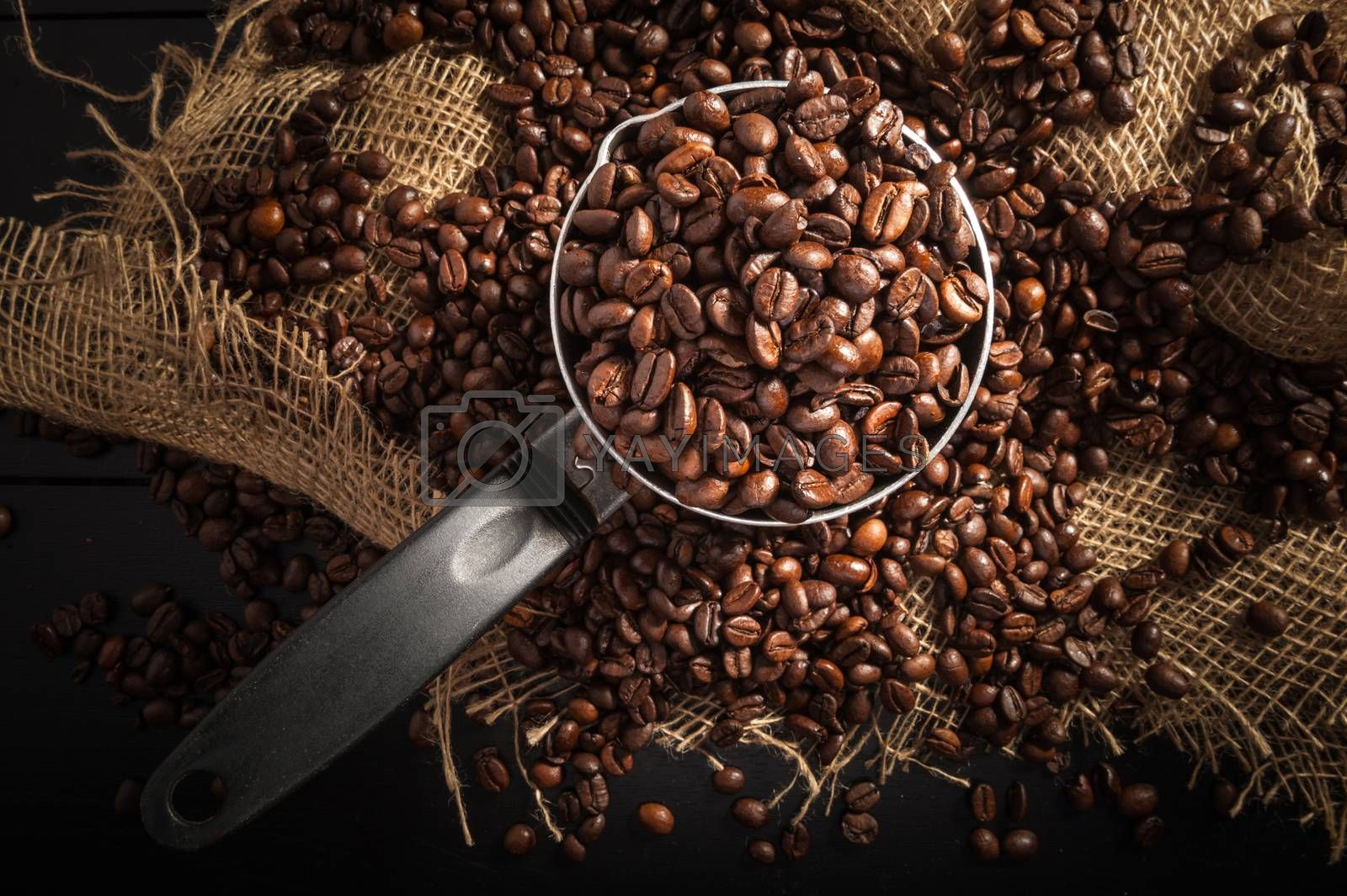 cezve with grain coffee on dark background