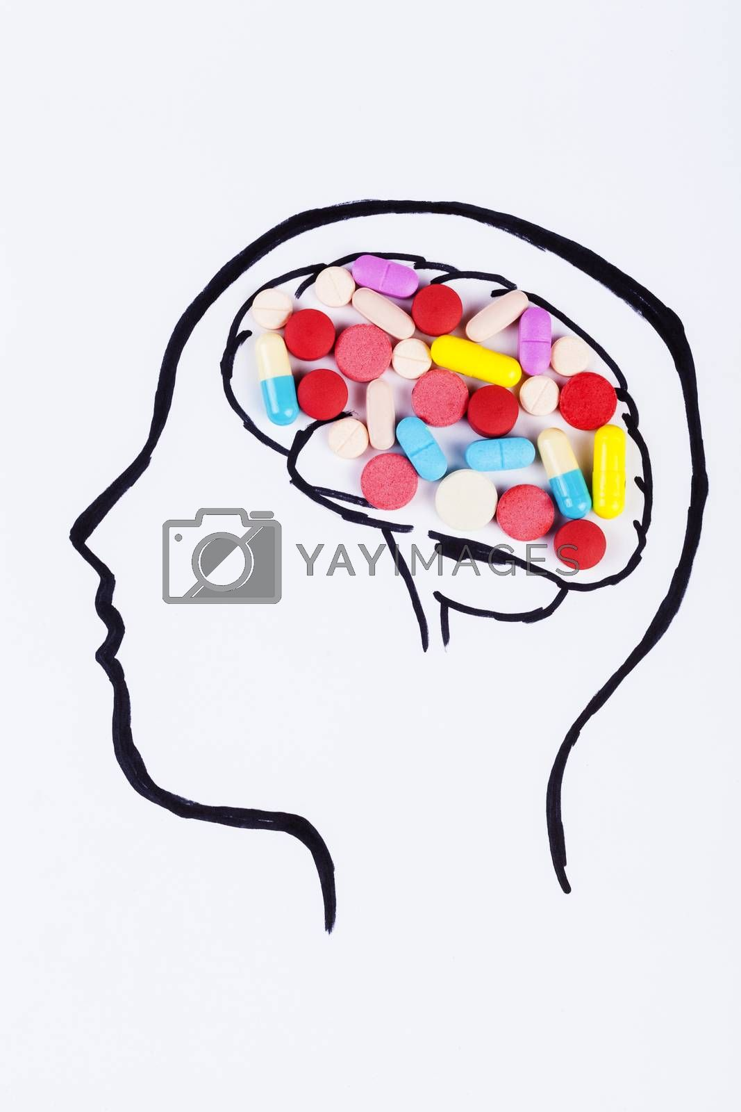 Human head hand drawing with colored pills in the brain
