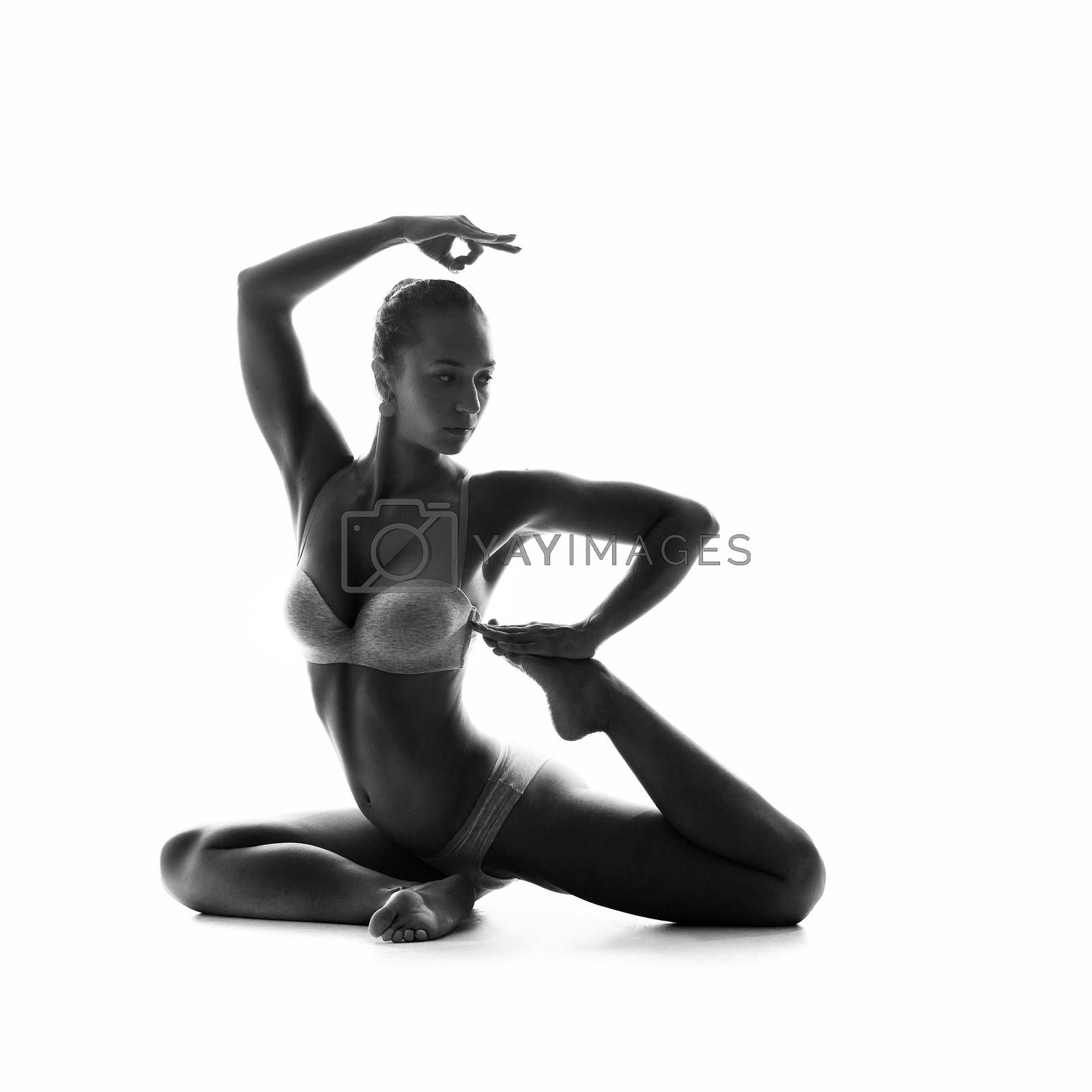 studio shoot of healthy latino woman doing yoga isolated over white
