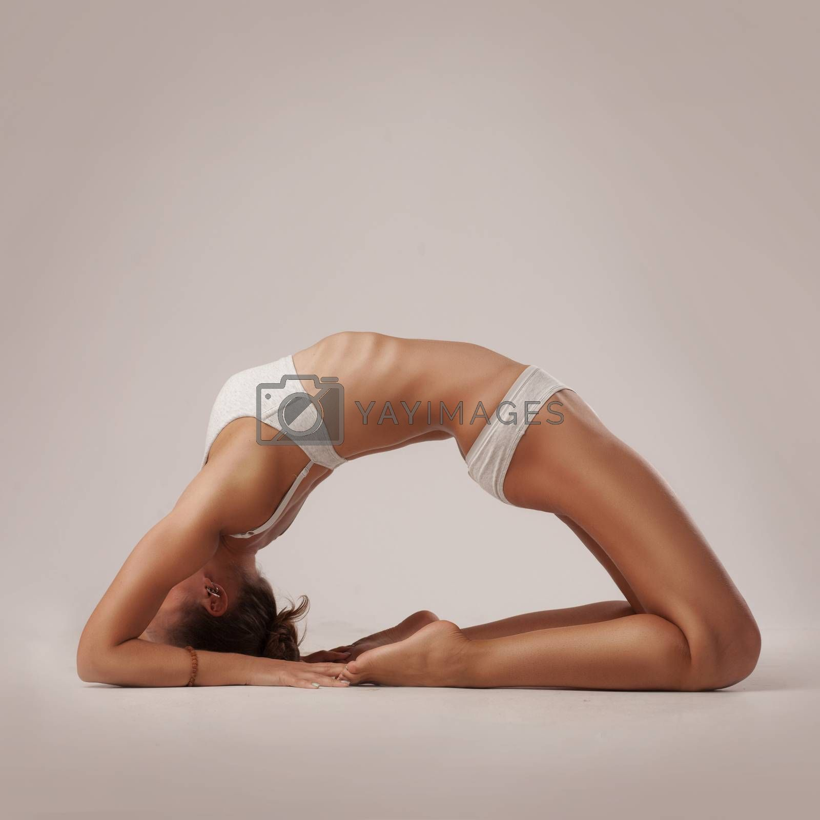 studio shoot of healthy latino woman doing yoga isolated