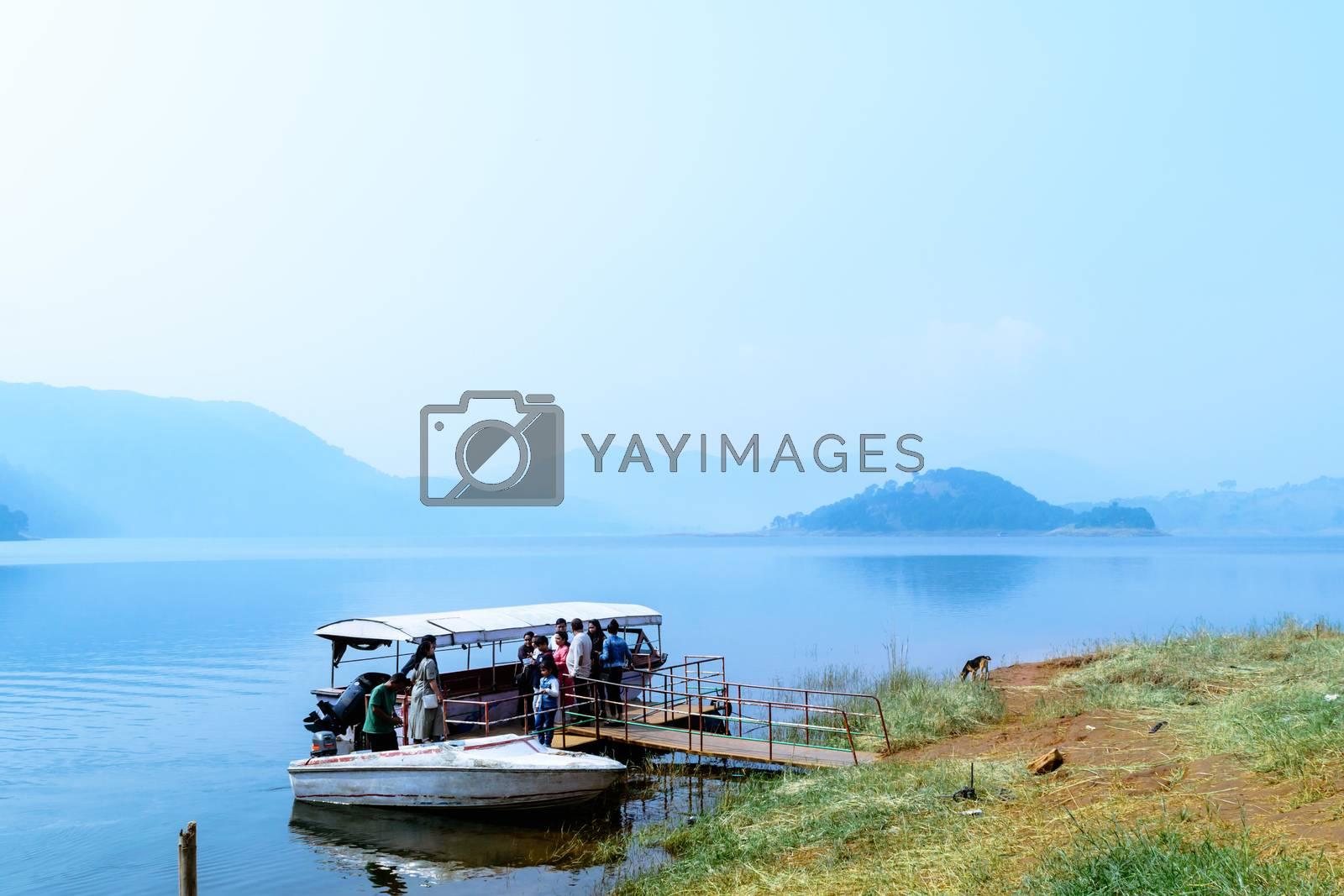 Umiam lake, shillong, Assam, India, December 15, 2017: Indian tourists people enjoying on travel holiday cruise boat tour.