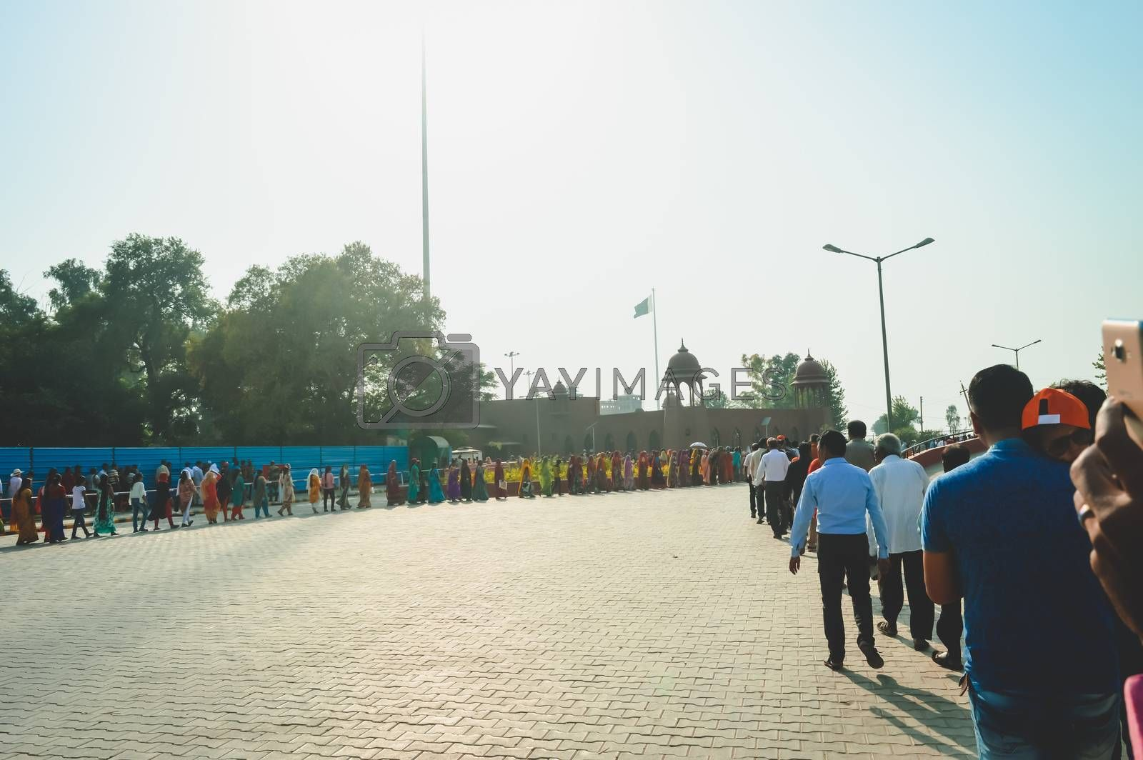 WAGHA BORDER, AMRITSAR, PUNJAB, INDIA - JUNE, 2017. People going to attend lowering of flags ceremony. Its a daily military practice security forces of India and Pakistan jointly followed since 1959.