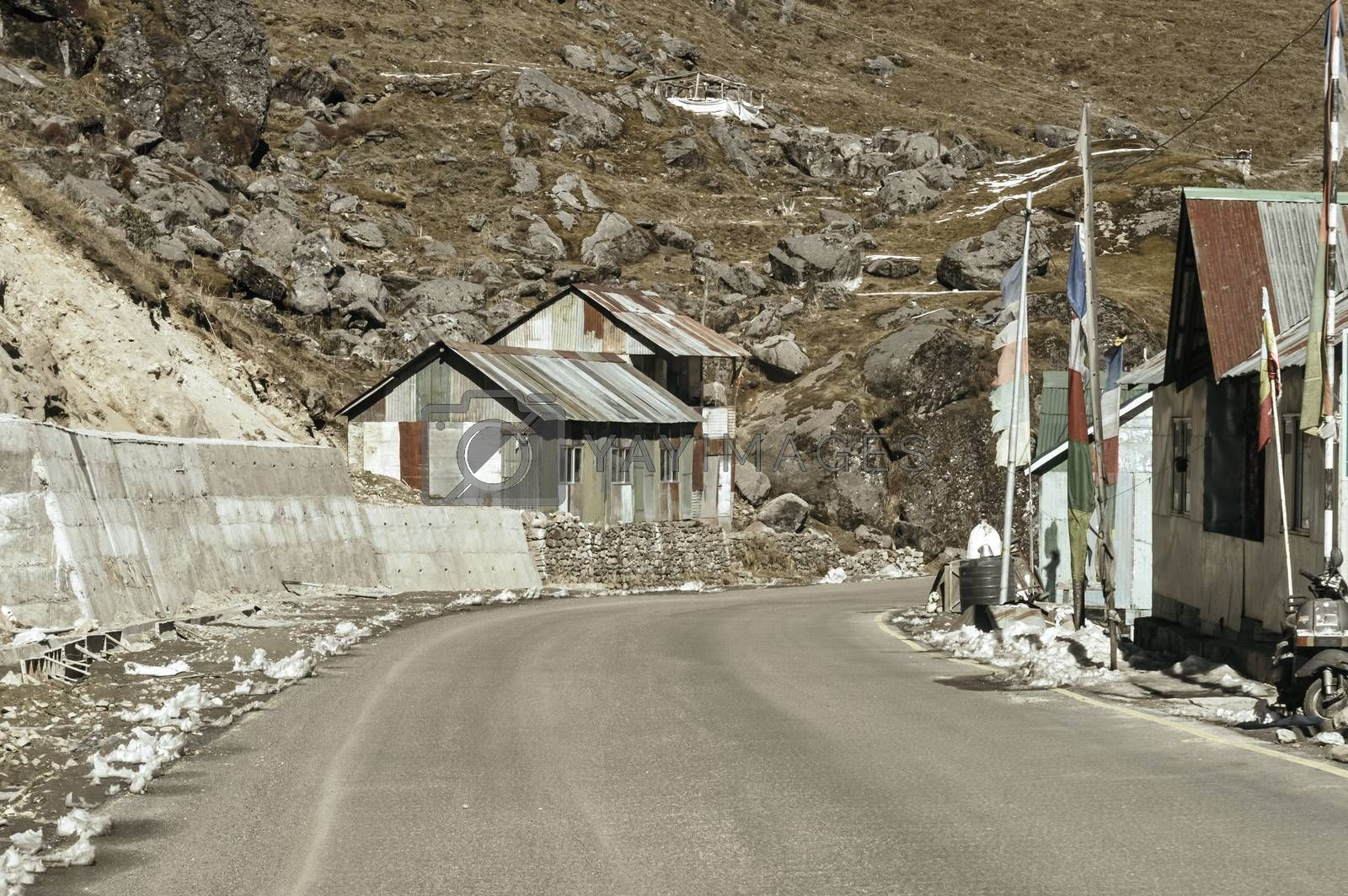 View of Military camp on a highway road side to Nathula Pass of India China border near Nathu La mountain pass in the Himalayas which connects Indian state Sikkim with China's Tibet Region.