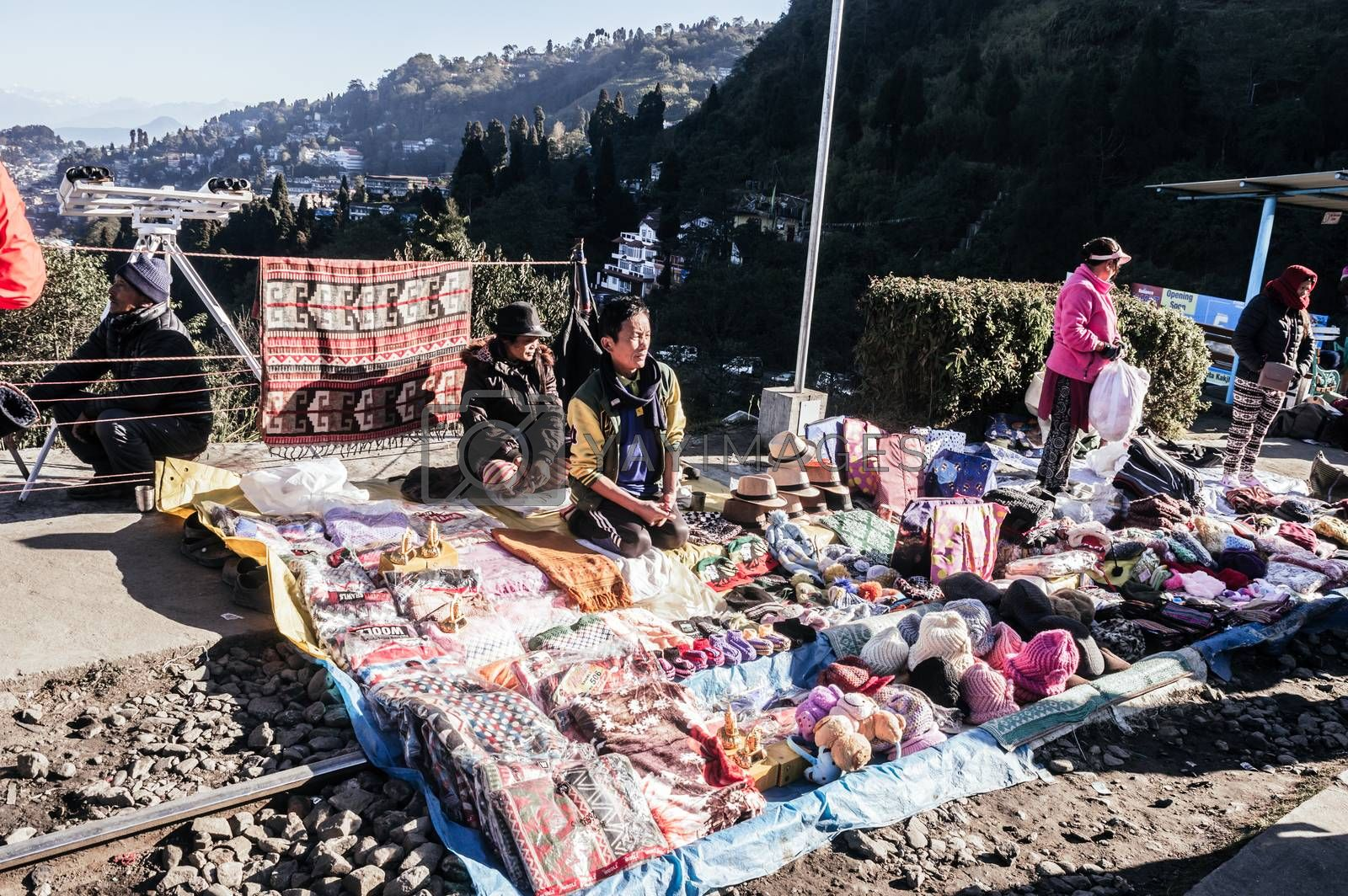 Batasia Loop, Darjeeling, 2 Jan 2019: Shopkeepers with their little makeshift stalls. Located in loop-line between Darjeeling and Ghum, a famous shopping area for fashion wears,handicrafts, woolens product.