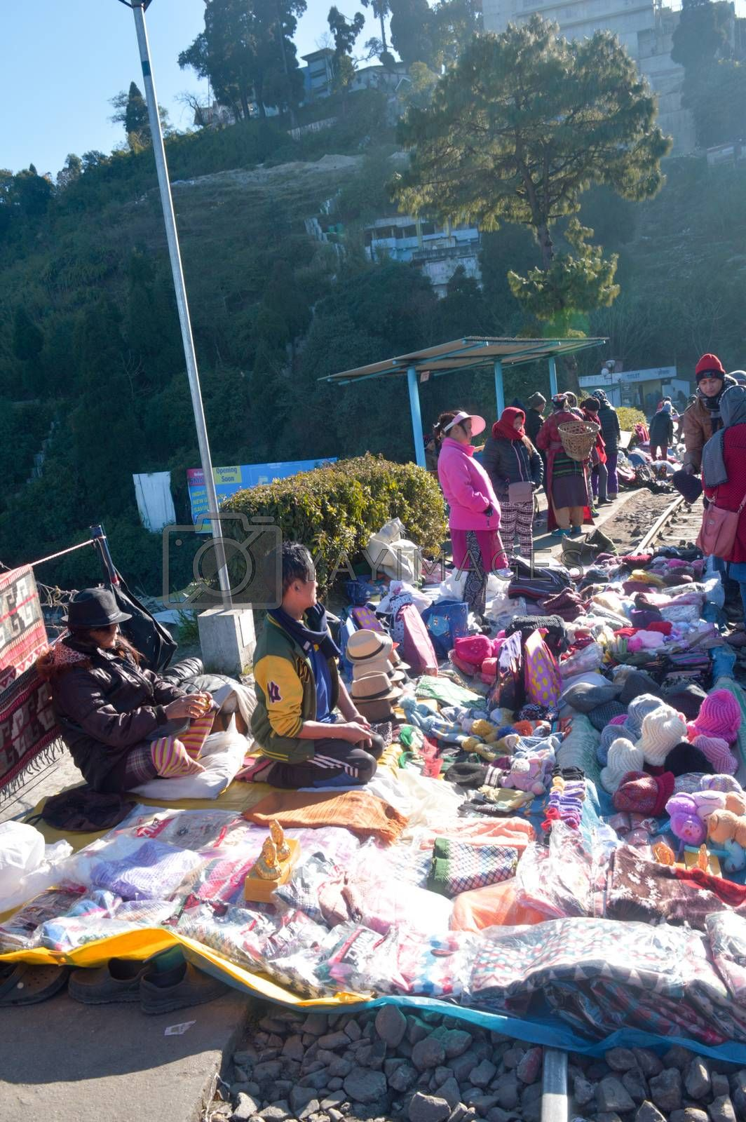 Batasia Loop, Darjeeling, 2 Jan 2019: Shopkeepers with their little makeshift stalls on the railway lines, wrap up their business with great agility and speed as the toy train arrives.