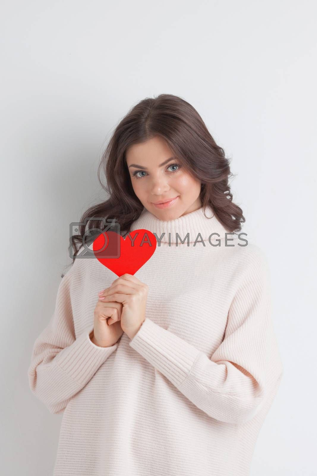 Woman holding paper heart shaped card . Valentine day concept . I'm looking waiting for partner ! Advertising people person relationship couple concept , white background