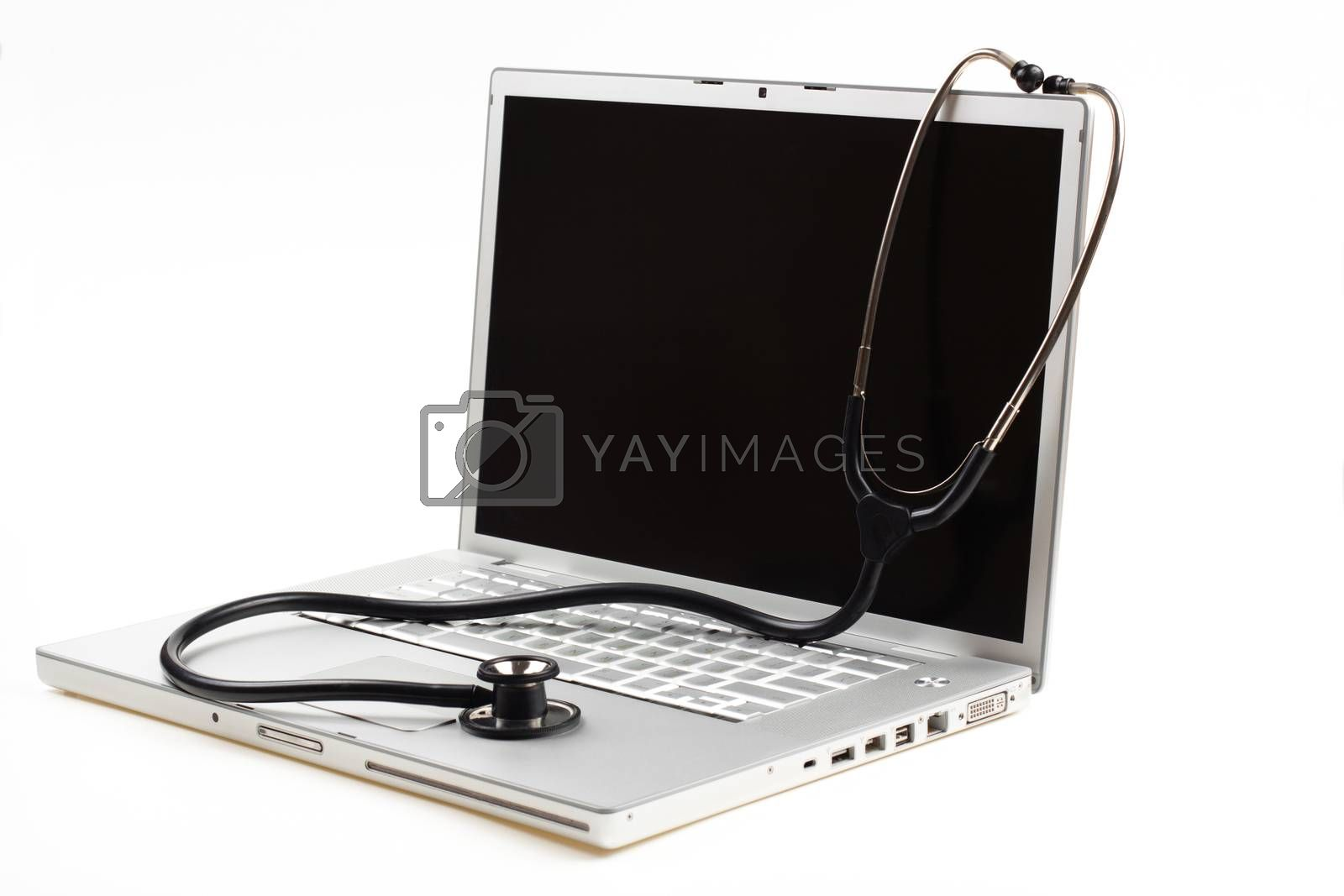 silver laptop diagnosis with black stethoscope  isolated on white background