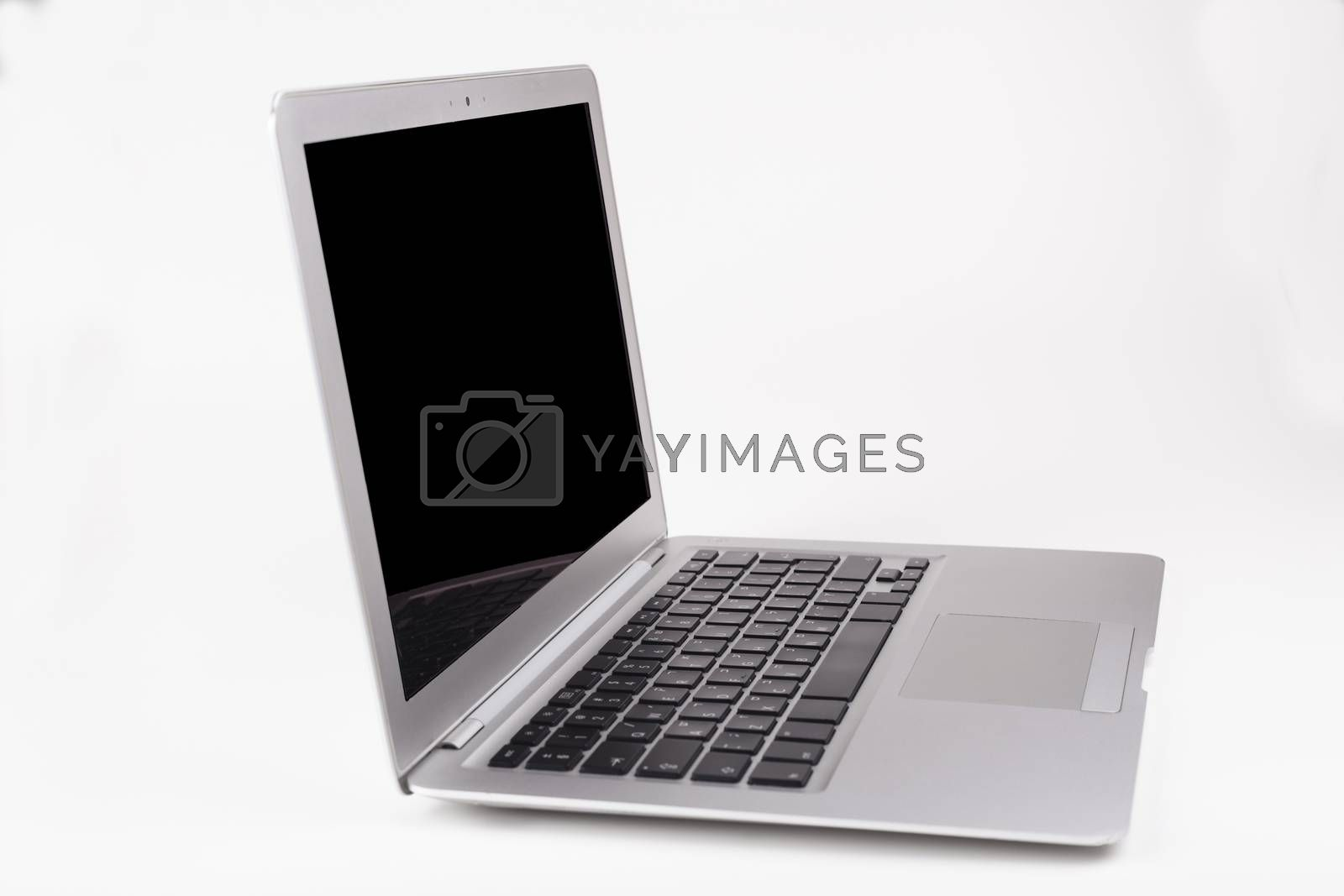 Thin silver laptop side view with black screen and keyboard reflection in the screen isolated on white background