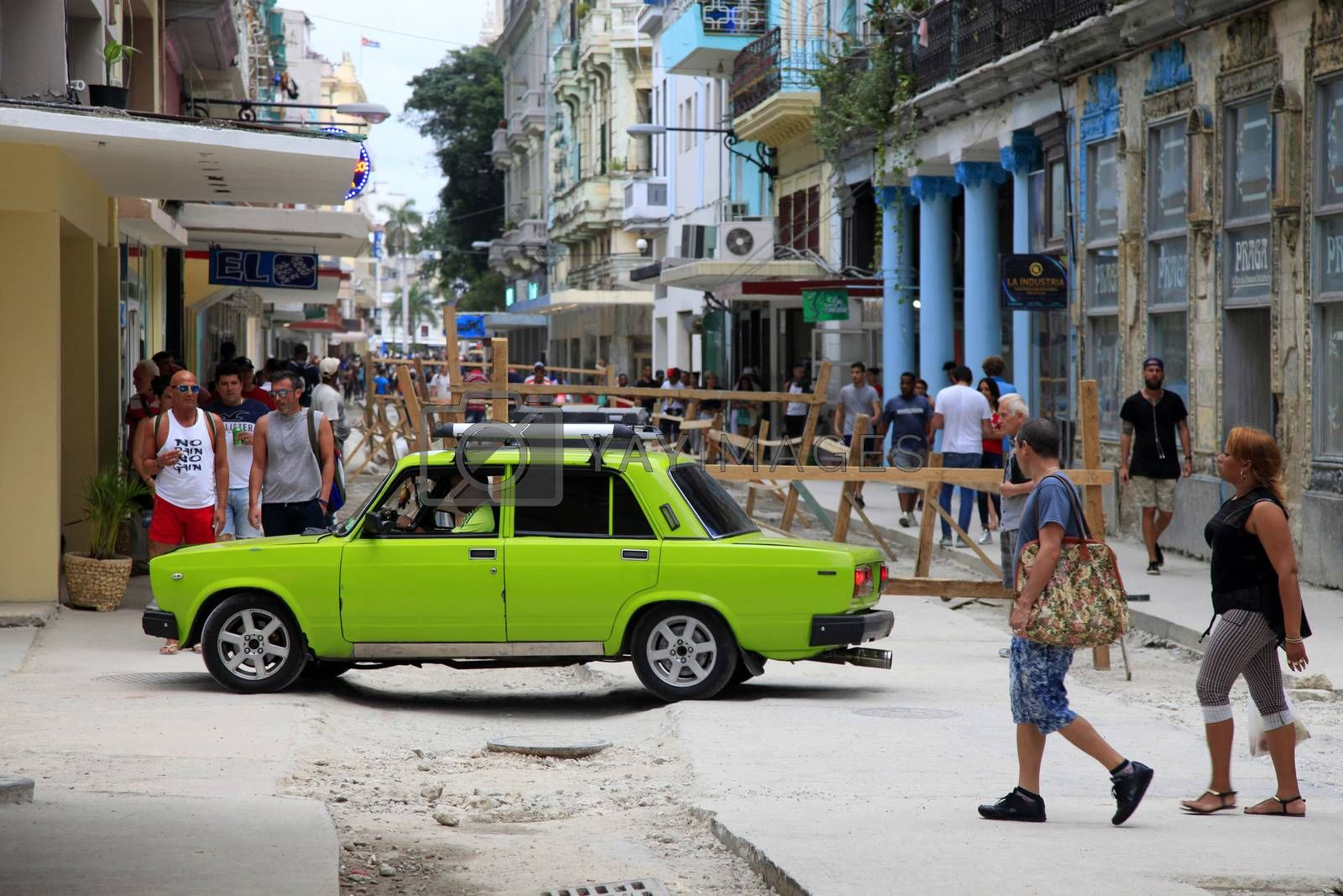 Havana, Сuba - January 10, 2019: Vintage cars moving on the streets of colorful Havana. A great variety of old cars exist In Cuba. On the streets cars from the first half of the 20th century can be found in magnificent conditions, which takes back in history and make the old atmosphere of the cities.