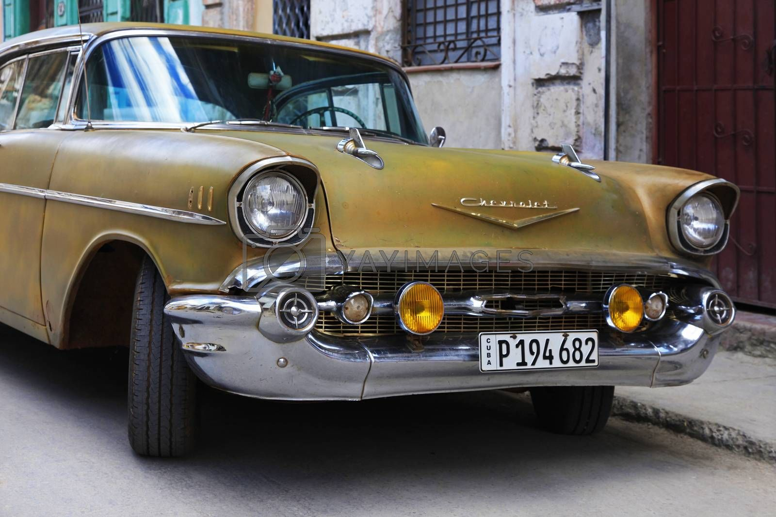 Havana, Сuba - January 11, 2019: Vintage cars moving on the streets of colorful Havana. A great variety of old cars exist In Cuba. On the streets cars from the first half of the 20th century can be found in magnificent conditions, which takes back in history and make the old atmosphere of the cities.