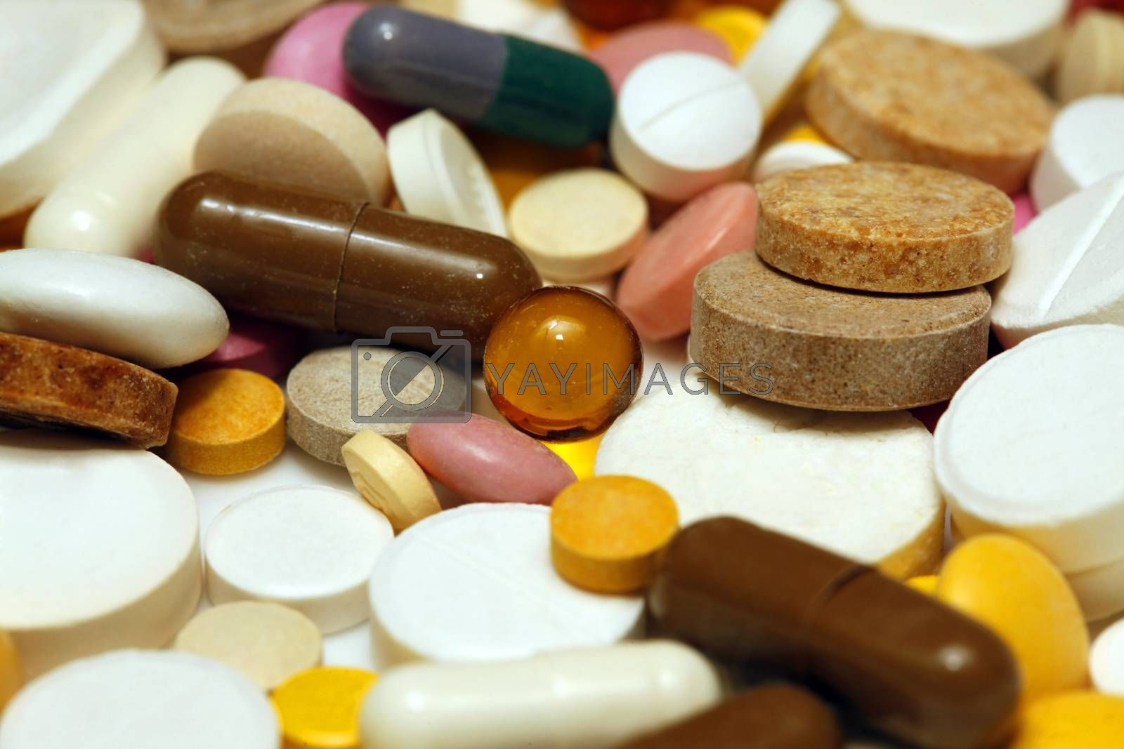 Assorted colorful pills and capsules close up, horizontal, selective focus, medical concept