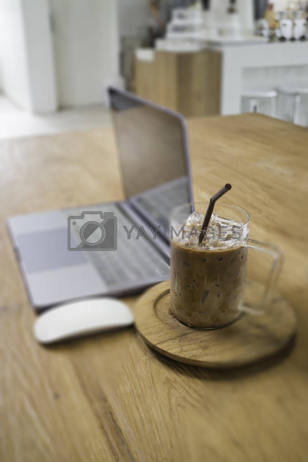 Comfortable work desk with notebook laptop, stock photo