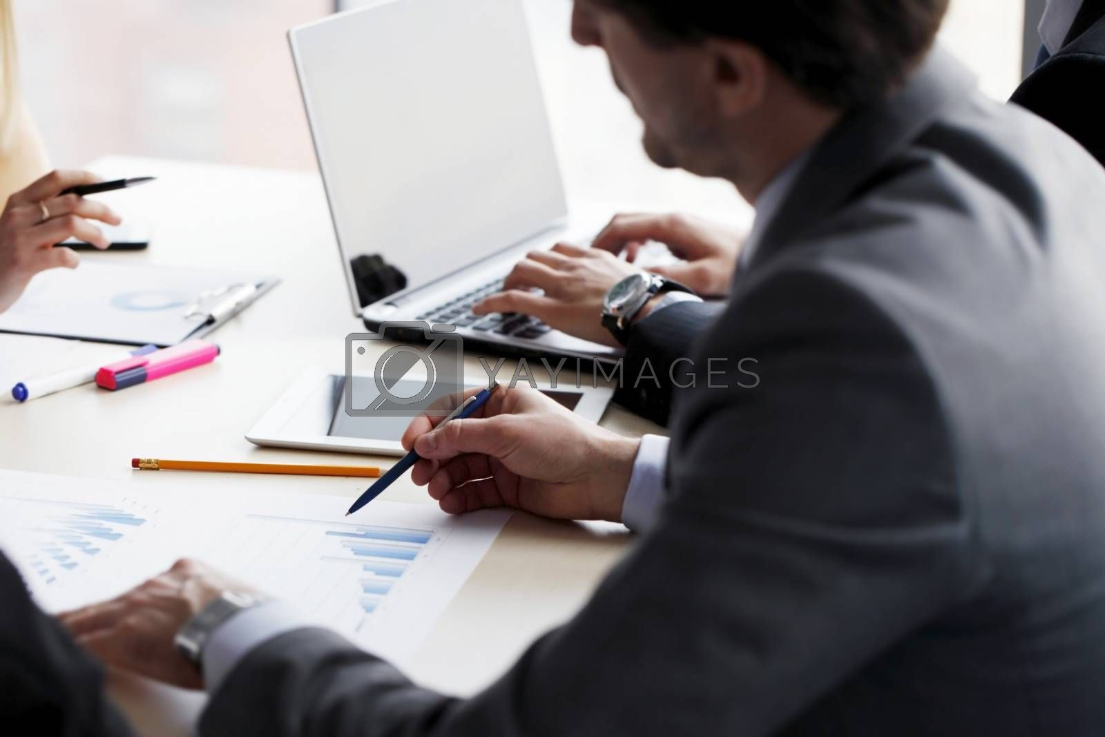 Business people working together with financial reports