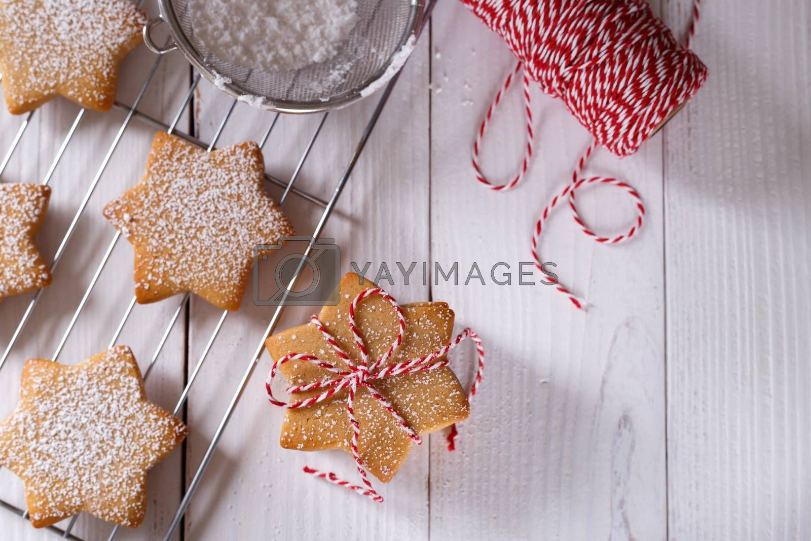 Christmas gingerbread shortbread cookies on white wooden table top view copy space