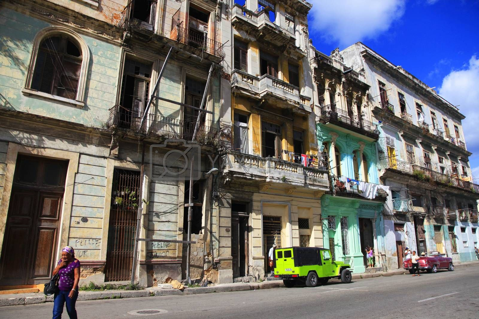 Royalty free image of Vintage cars on the streets of colorful Havana by friday