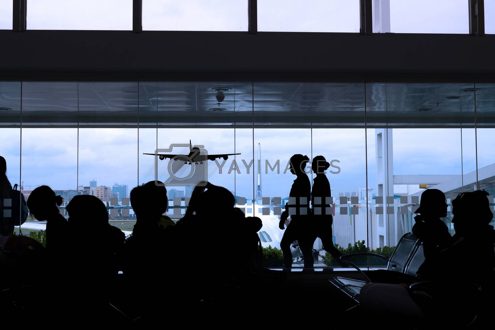 silhouette of airport lounge by morrbyte