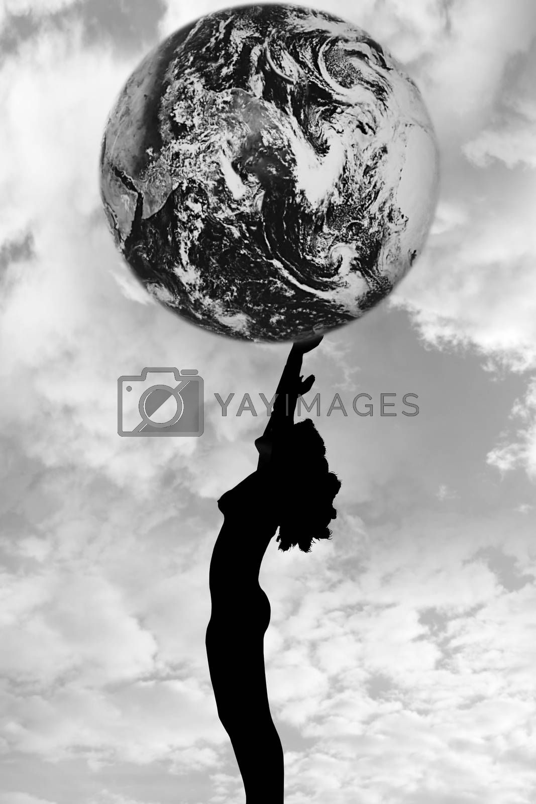 attractive silhouetted nude woman holding the earth giving gratitude to the heavens in a yoga pose with a cloudy background