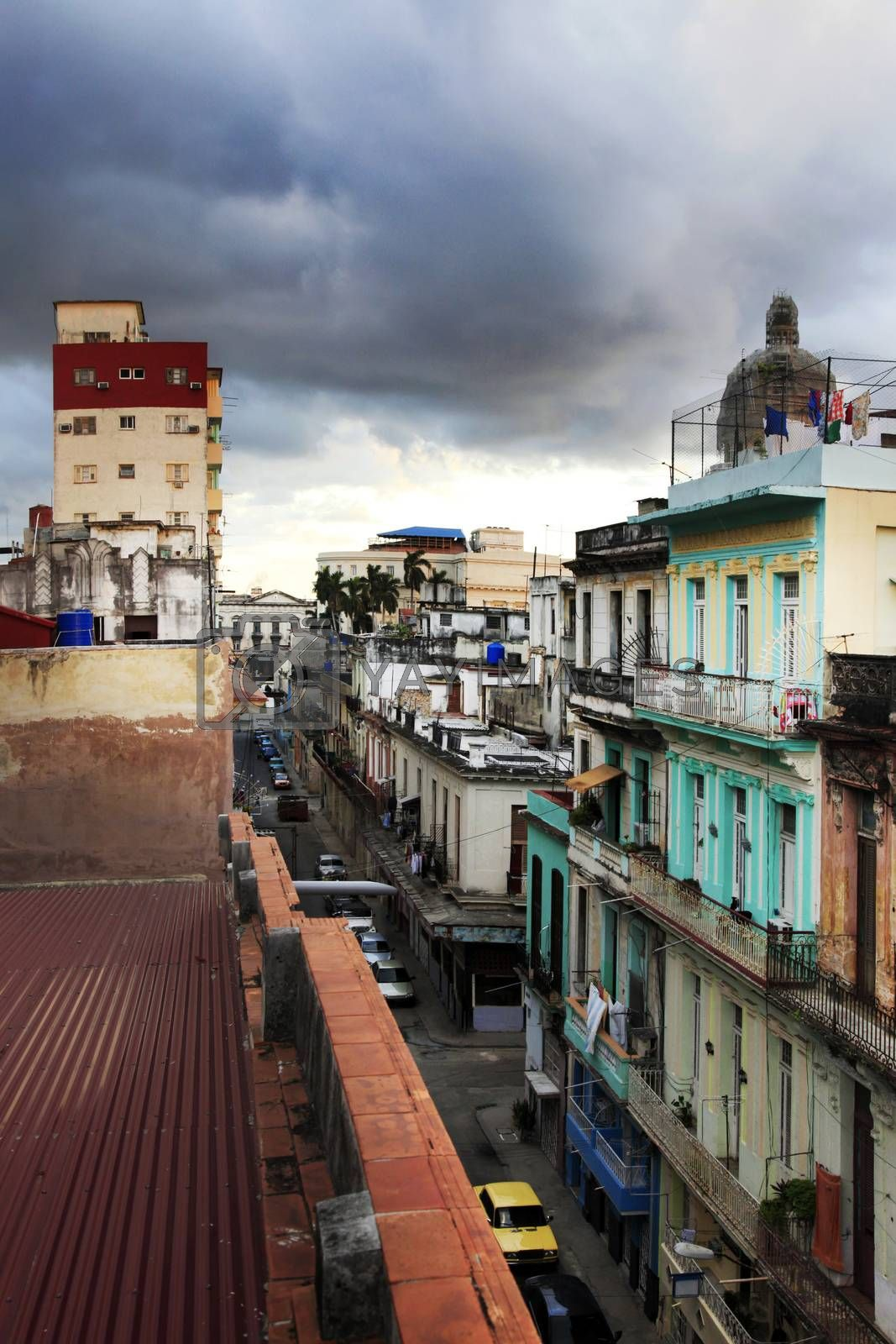 Street San Martin in Havana with former Presidential Palace dome in background