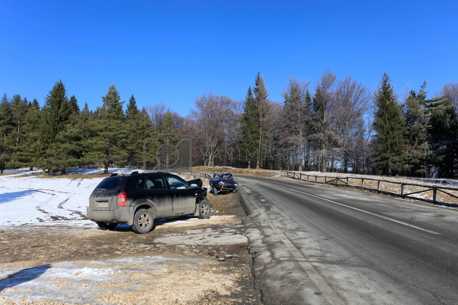 Two cars damaged by crash accident on side of the road