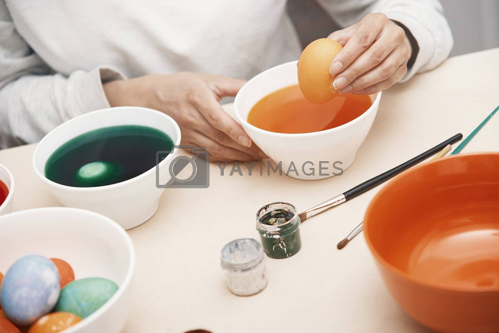 Woman preparing Easter eggs by Novic