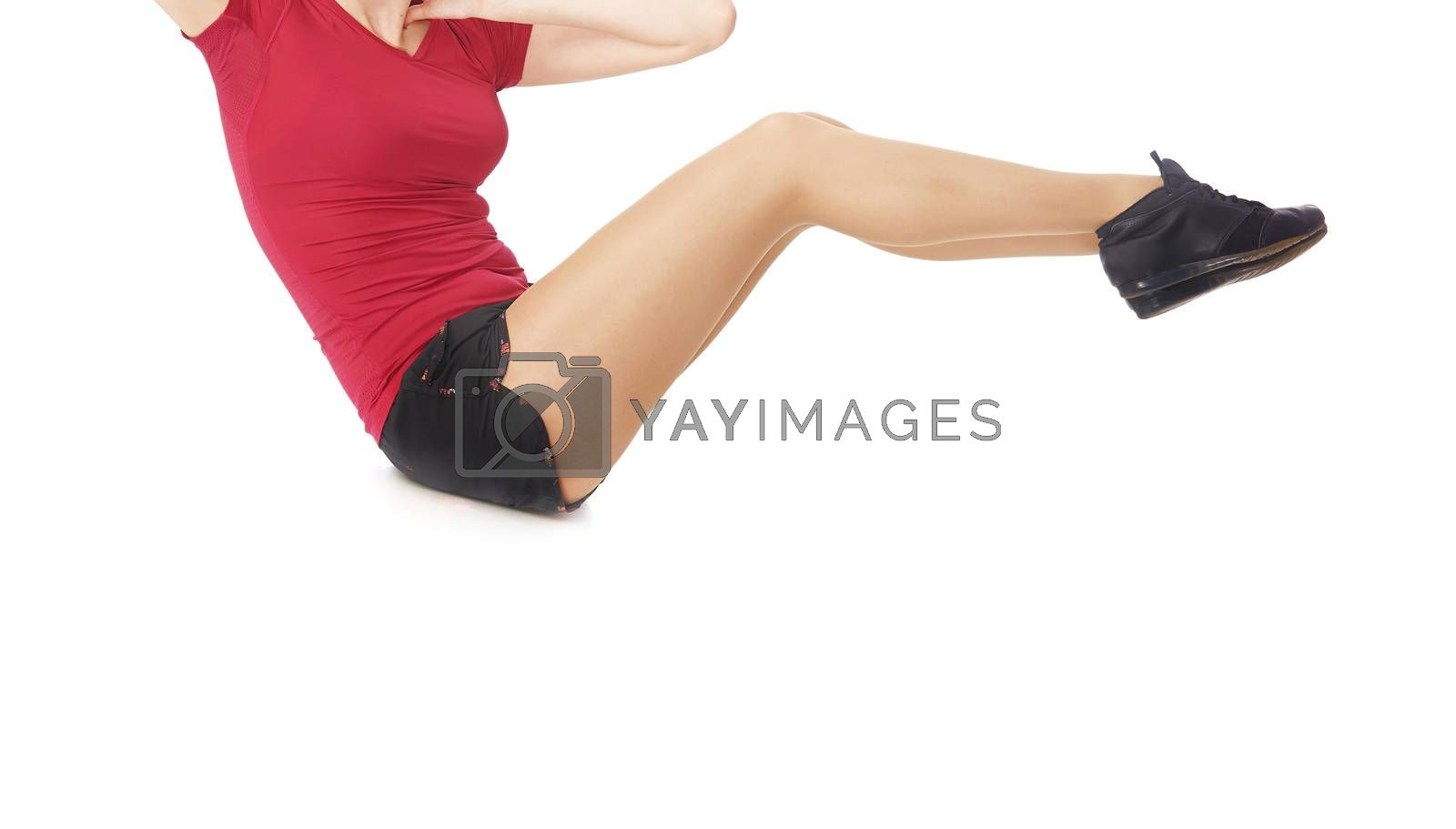 Fitness woman doing sit-ups exercise on a white background