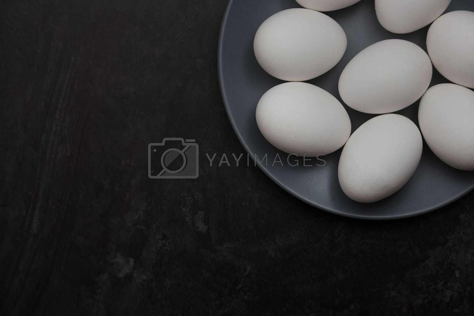 Chicken eggs on a plate by Novic