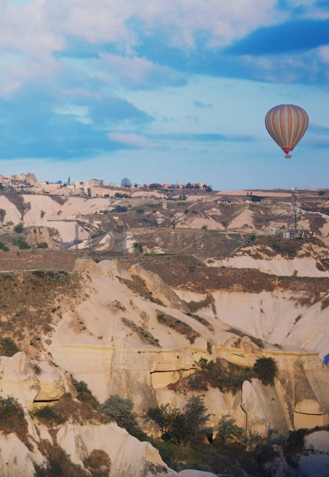 Hot air balloon flying over the rocks of Cappadocia, Turkey