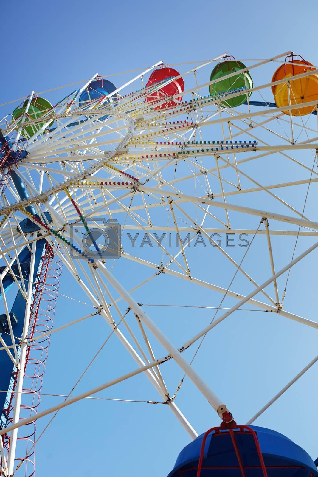 Ferris wheel in public amusement park. Low angle view