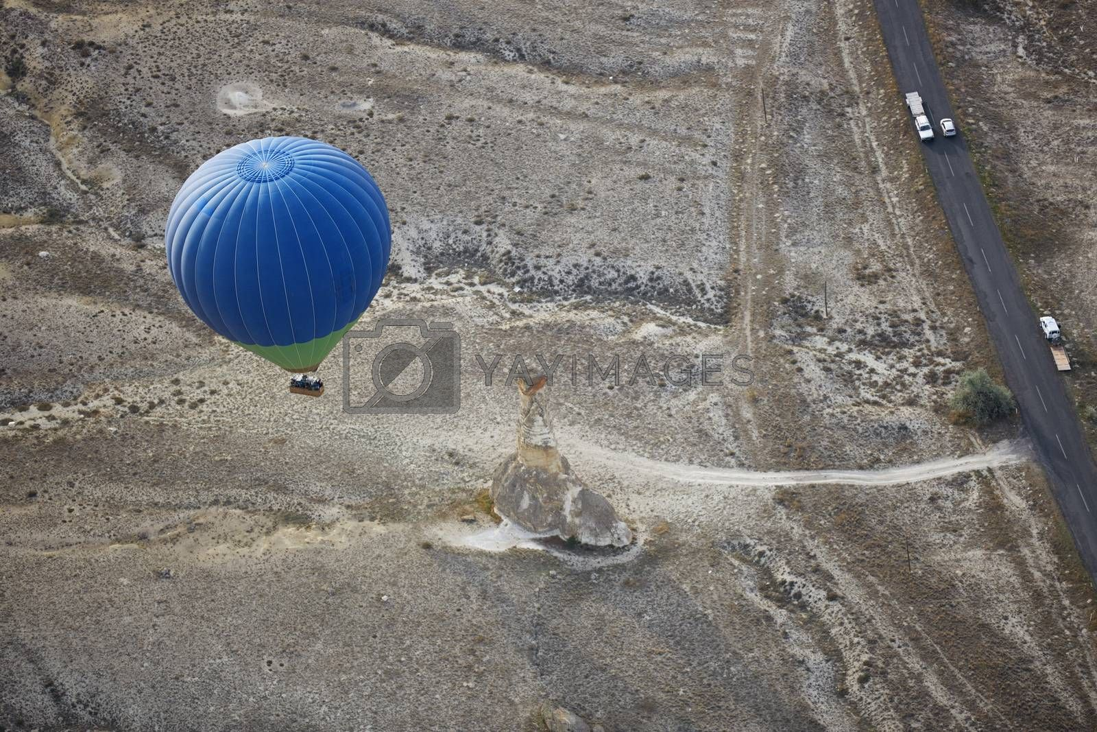 Blur hot air balloon flying over the road with motor transport. View from above