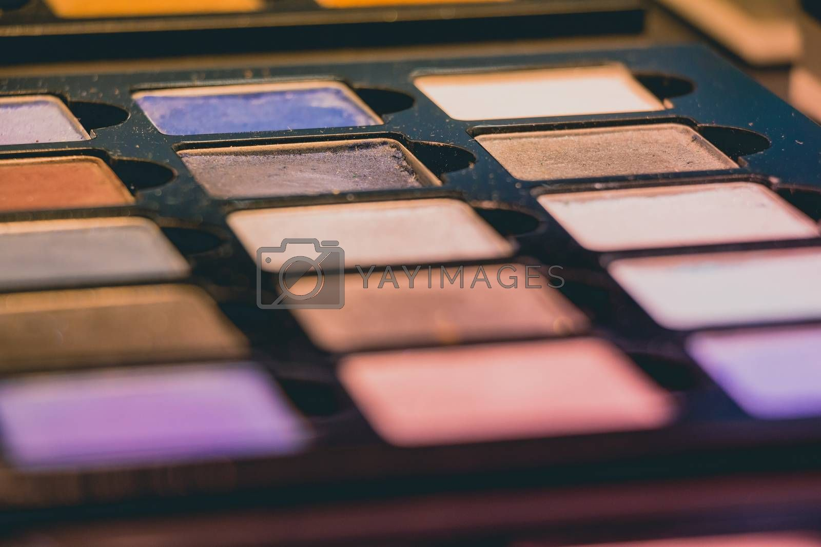 Closeup of colorful makeup cosmetic eyeshadow palette.