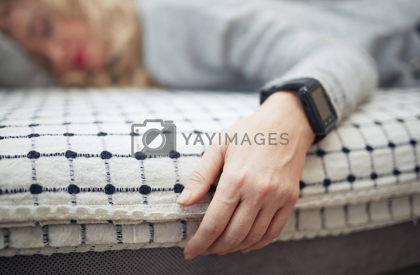 Royalty free image of Woman sleeping with smart watch by Novic