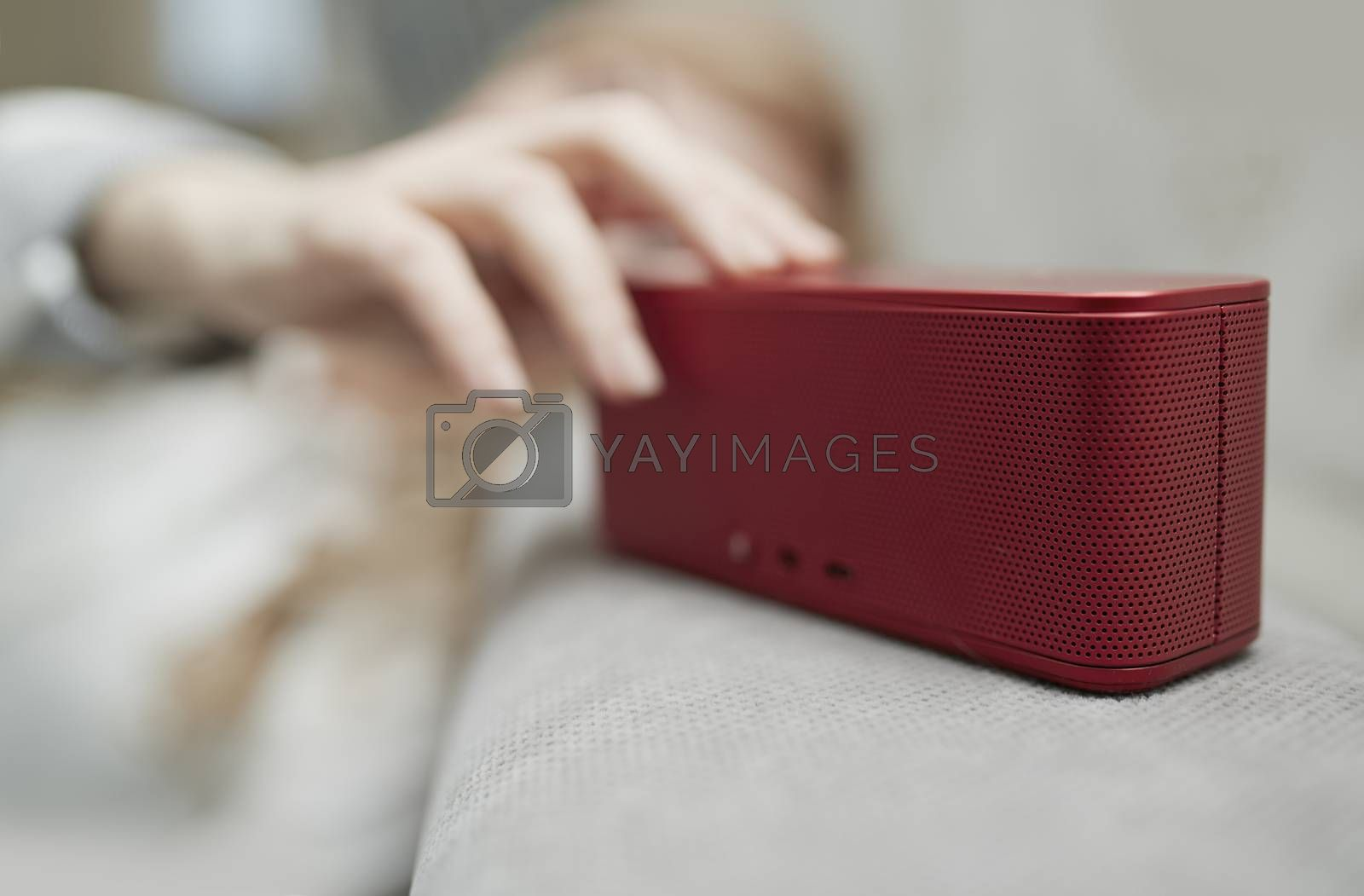 Woman using portable wireless speaker