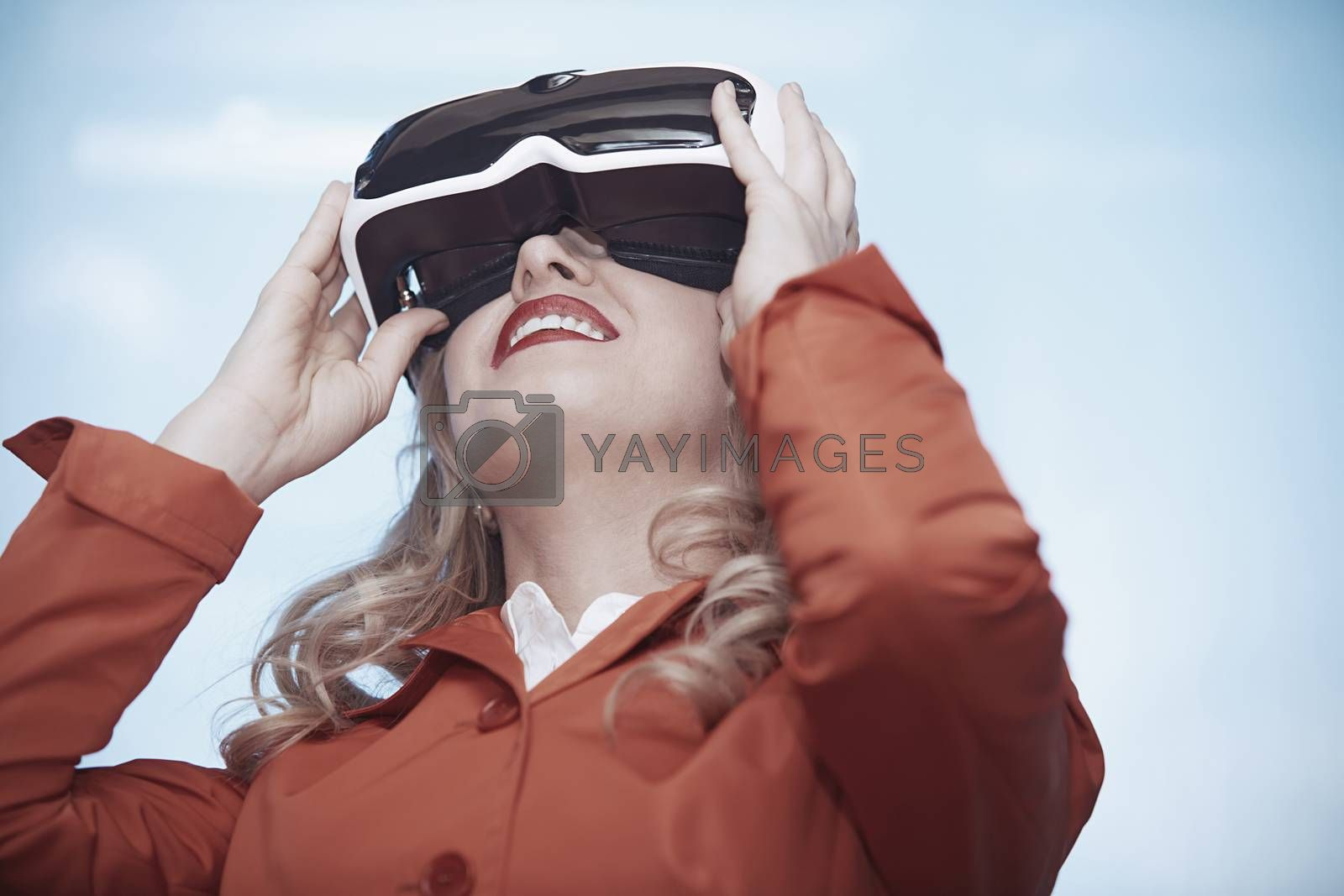 Woman at office wearing Virtual reality headset by Novic