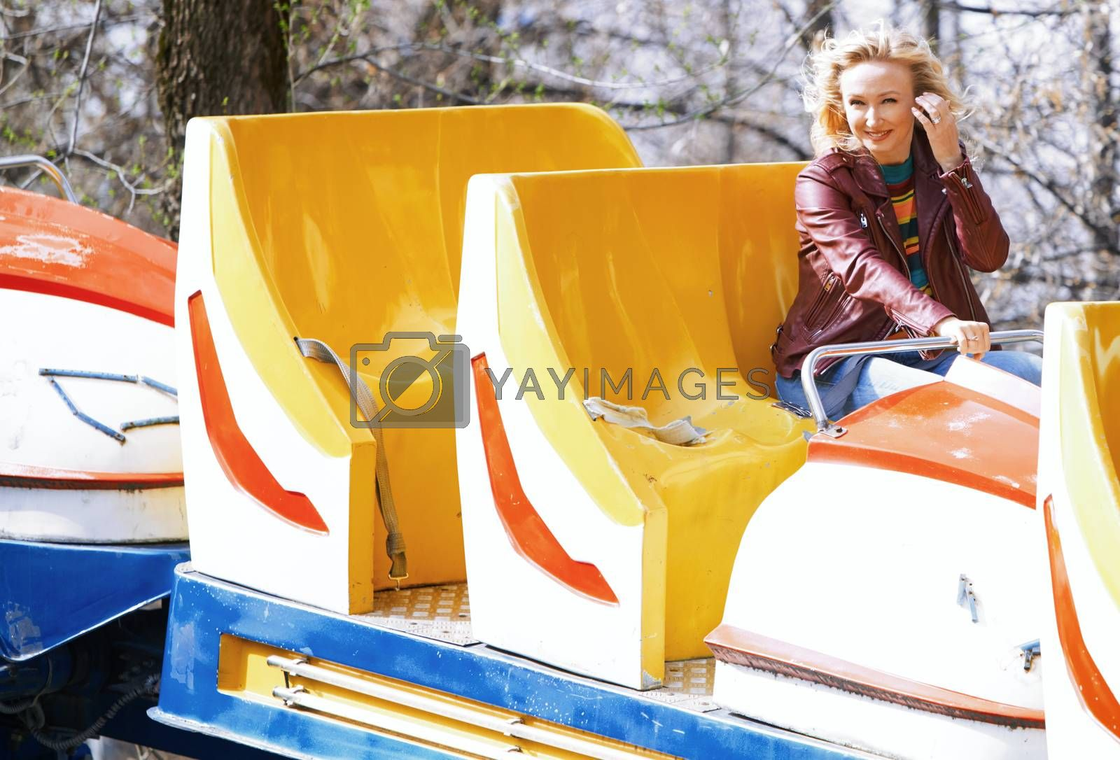 Blond woman having fun and riding on a rollercoaster