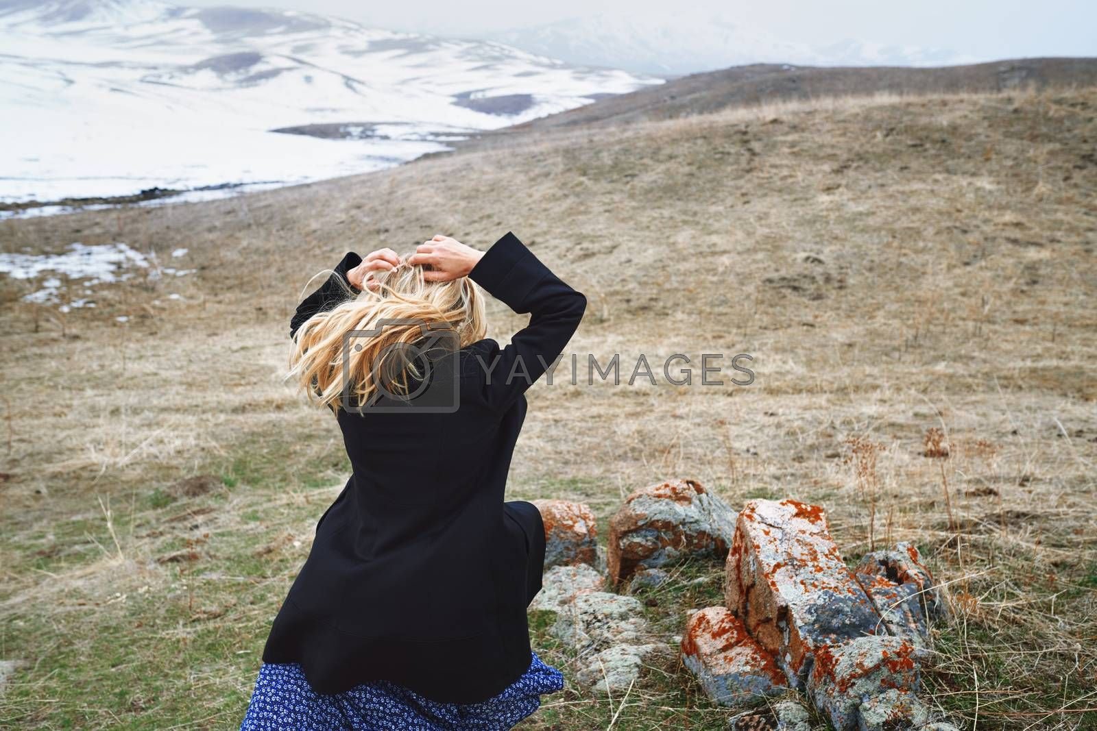 Woman running away in the winter landscape
