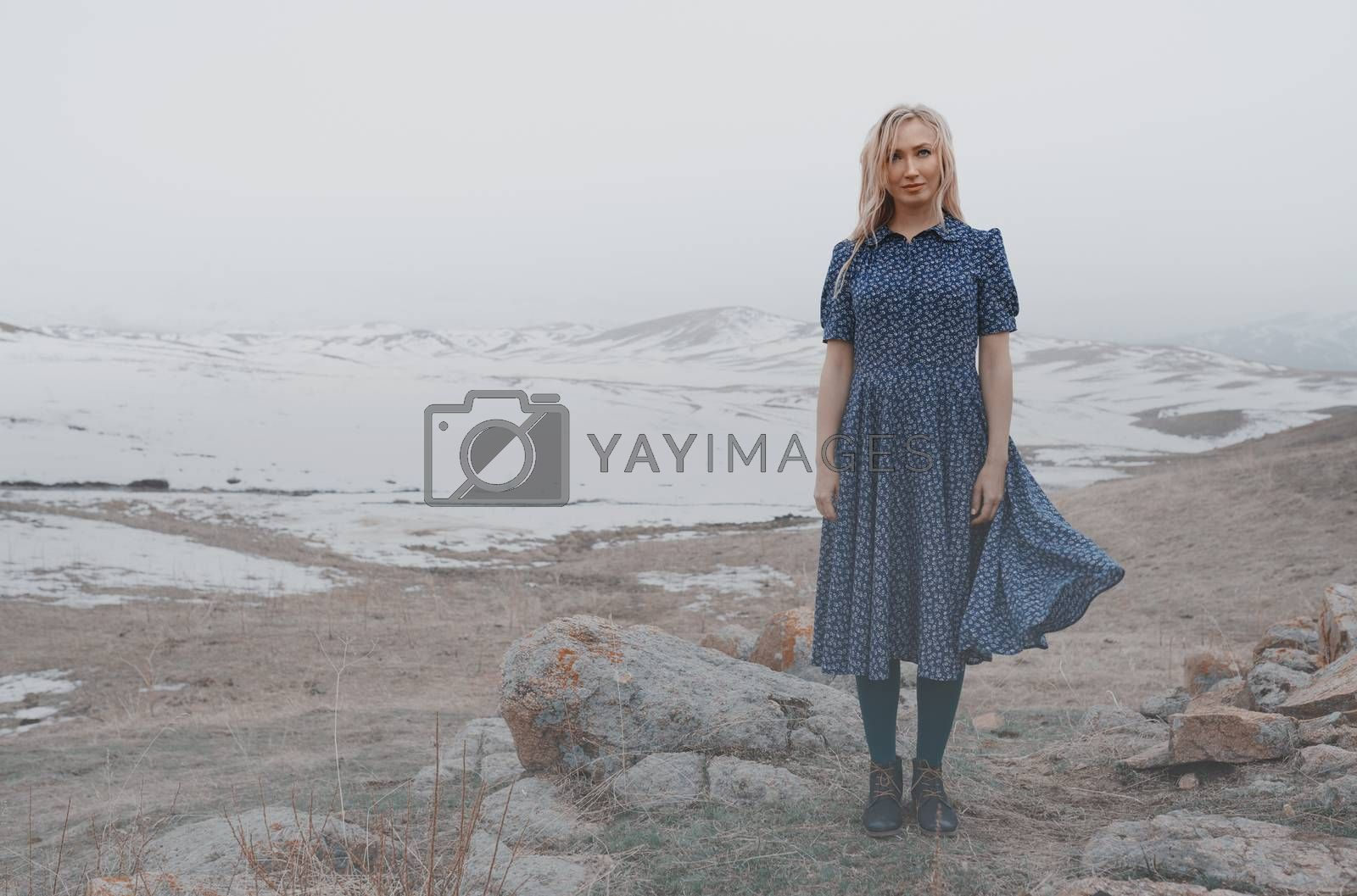 Happy woman having fun in the winter landscape