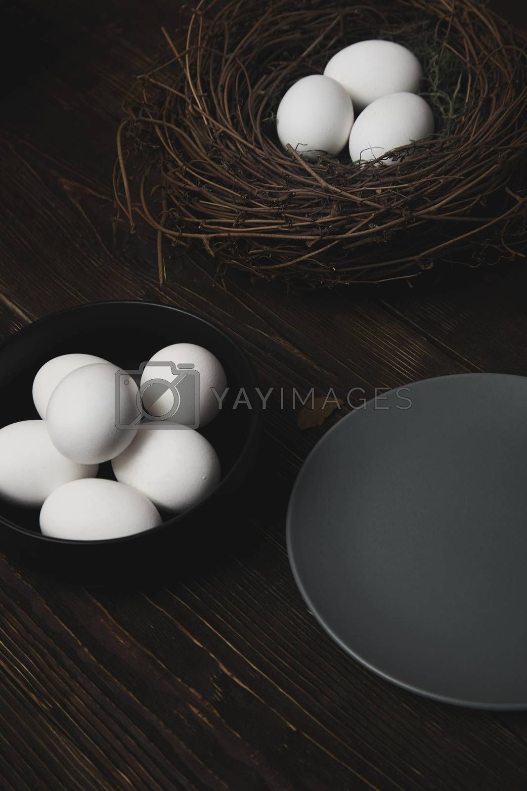 Easter eggs and bird nest on a rustic wooden table