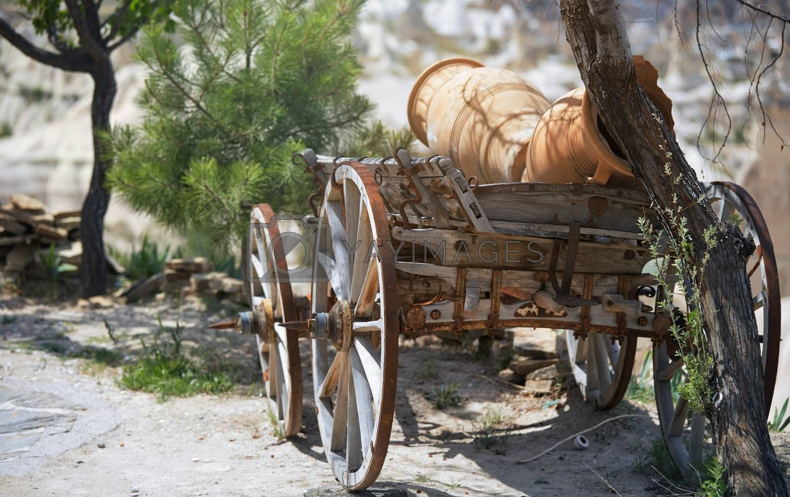 Ancient wooden wheeled wagon with pots