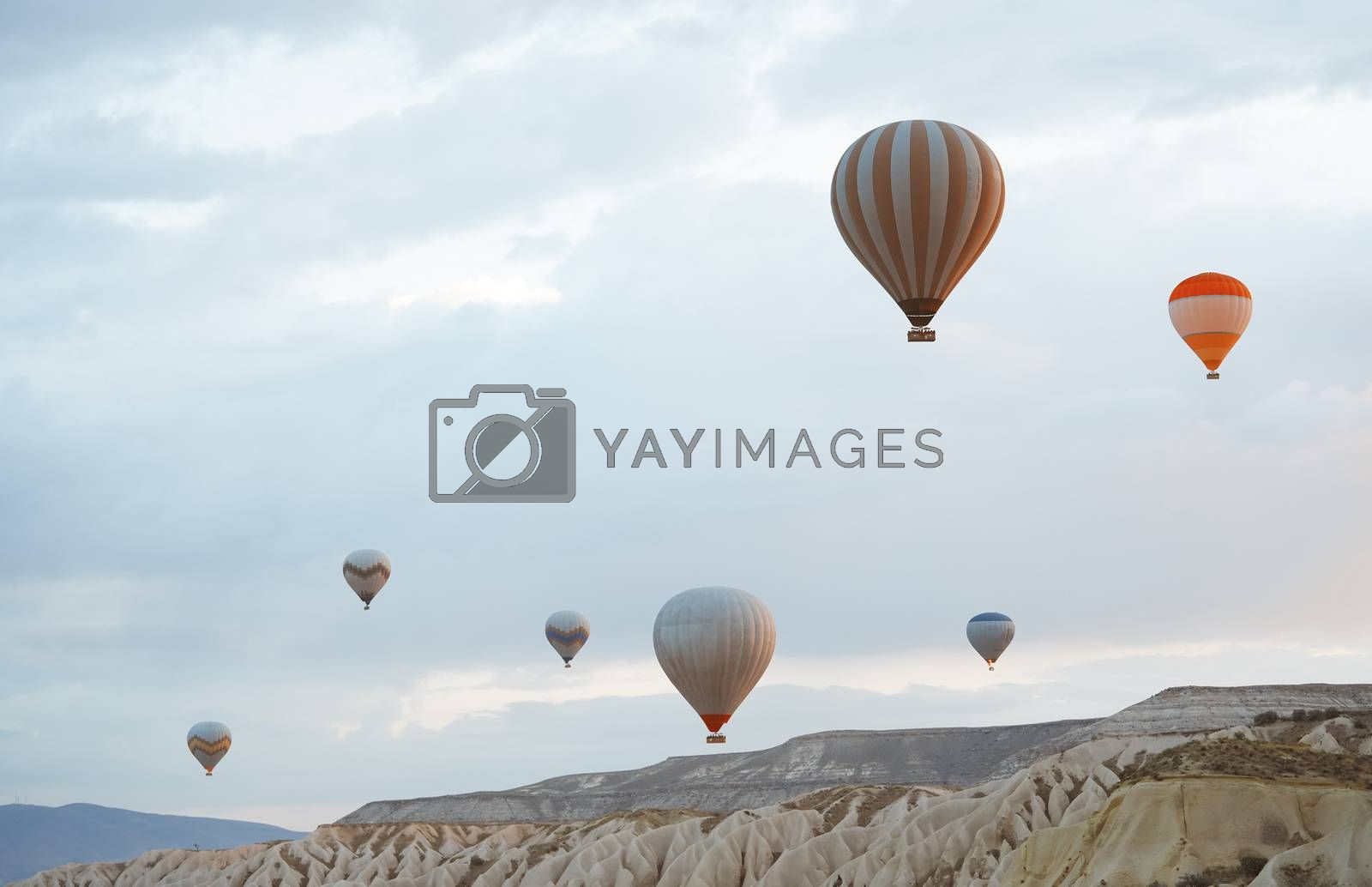 Hot air balloons flying over the rocks of Cappadocia, Turkey