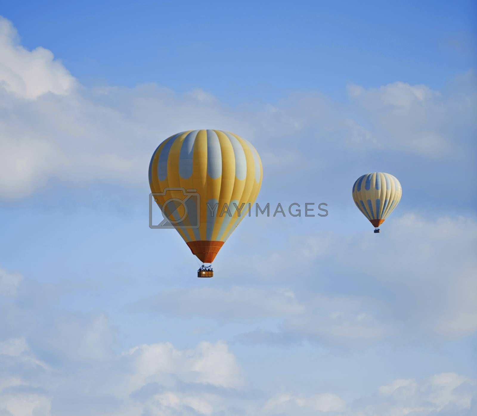 Two hot air balloons flying in the sky