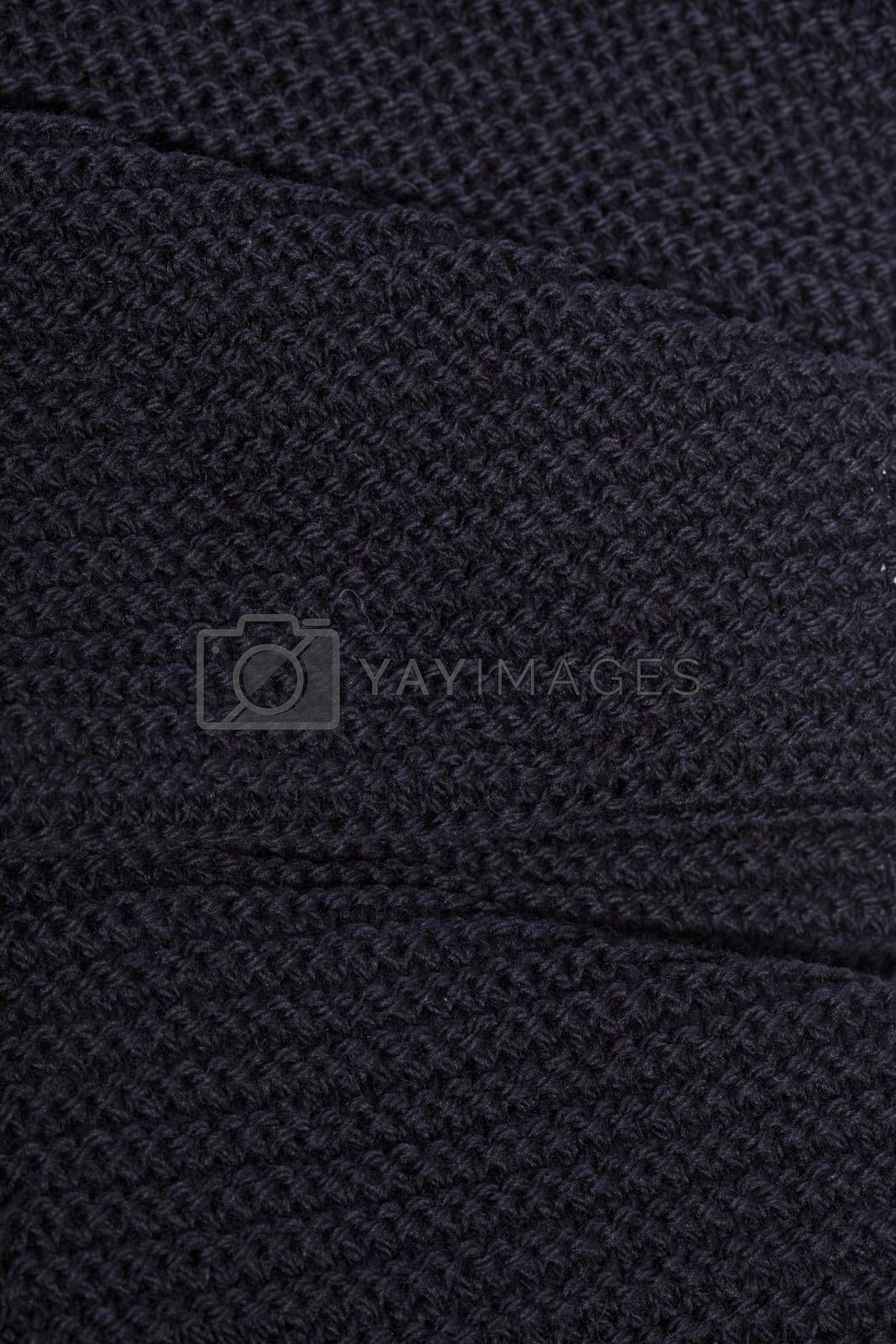 Knitted black scarf texture background.