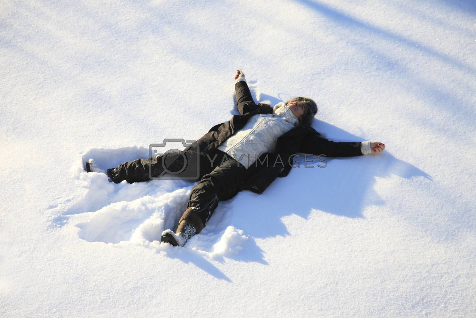Adult woman lying on clear snow