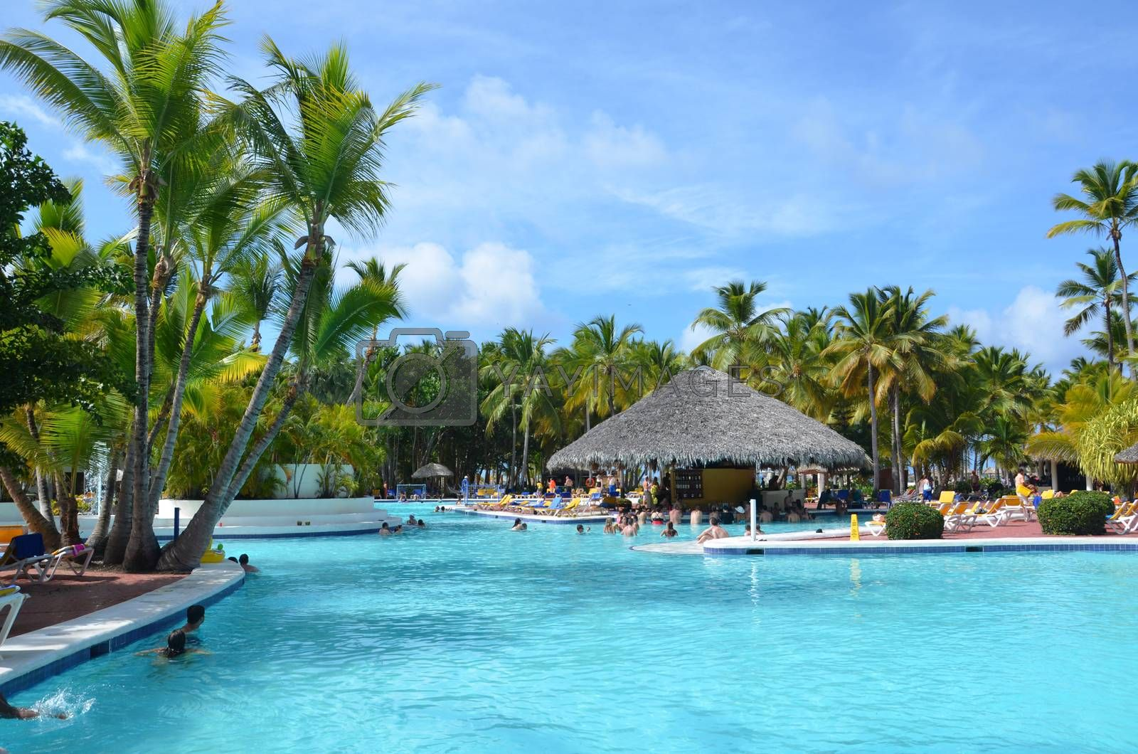 Beautiful luxury swimming pool at a tropical resort, People relax at the hotel