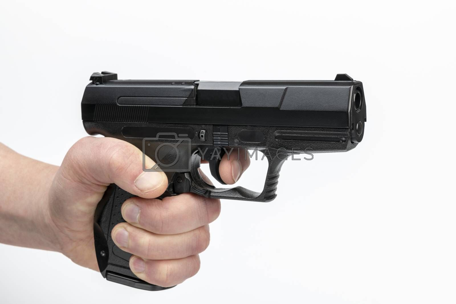 Hand of a male with firearm being a black pistol