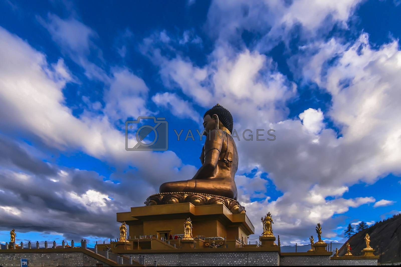 Royalty free image of Side view of the gilded gold Buddha Dordenma in East Thimphu, Bhutan by juliachan