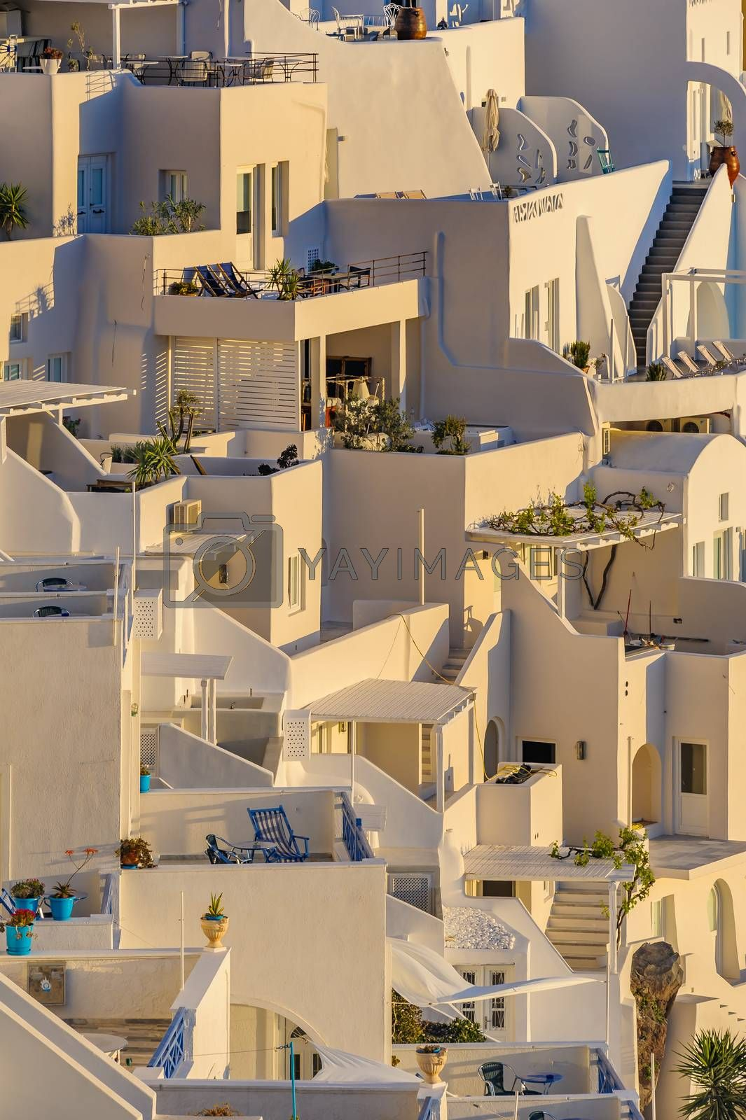 Typical view of Fira village patios at sunset, Santorini island, Greece