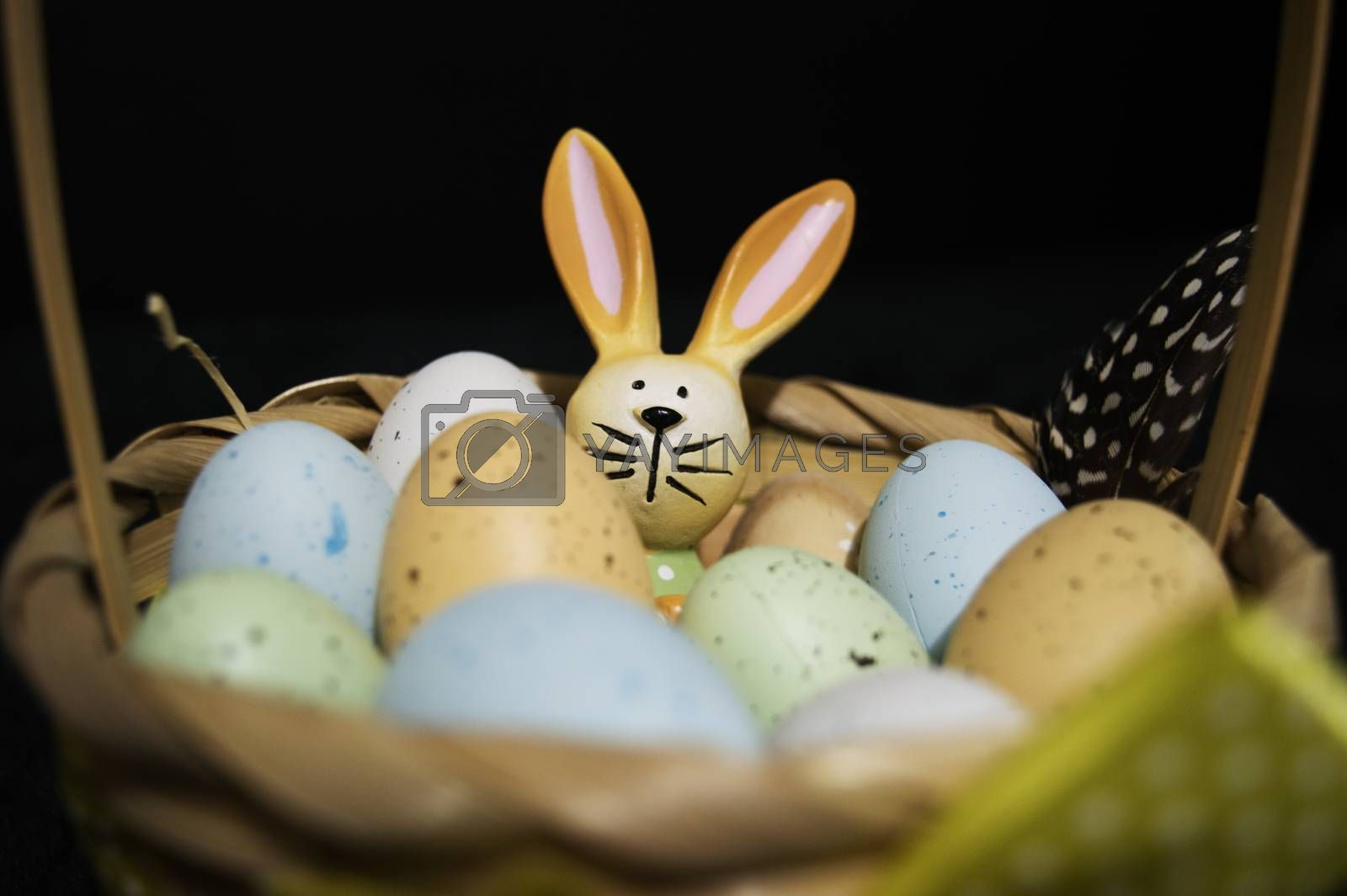 Easter Bunny in between colorful Easter eggs